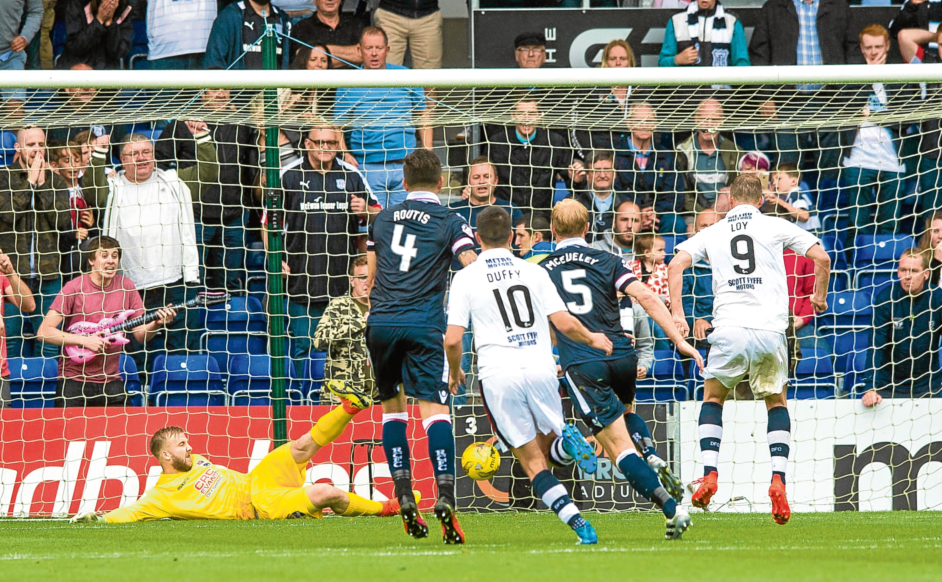 Rory Loy (No 9) nets his second goal in Saturday's 3-1 win at Ross County from the penalty spot.