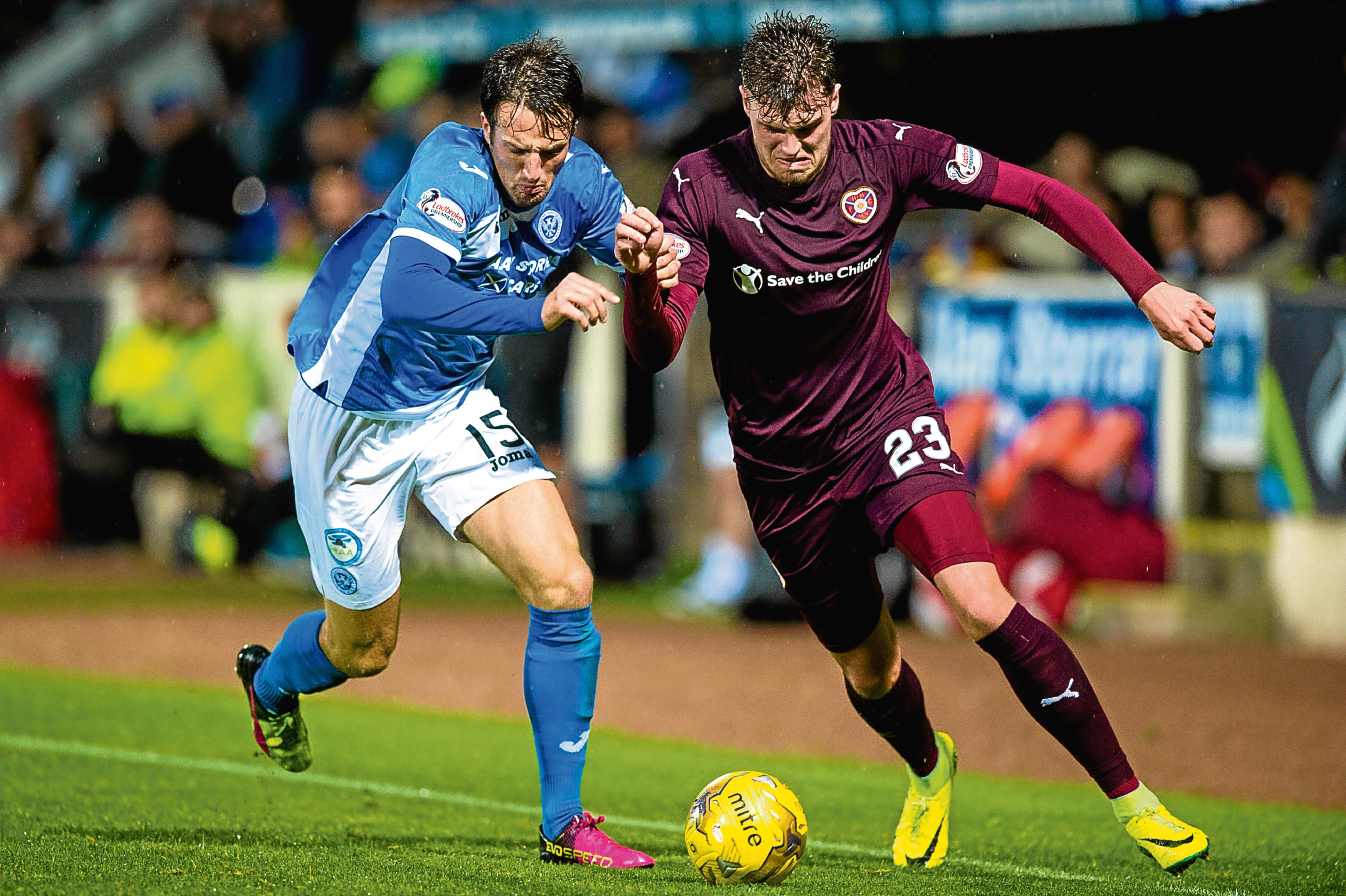 St Johnstone's Brad McKay and Hearts' Robbie Muirhead tussle for the ball