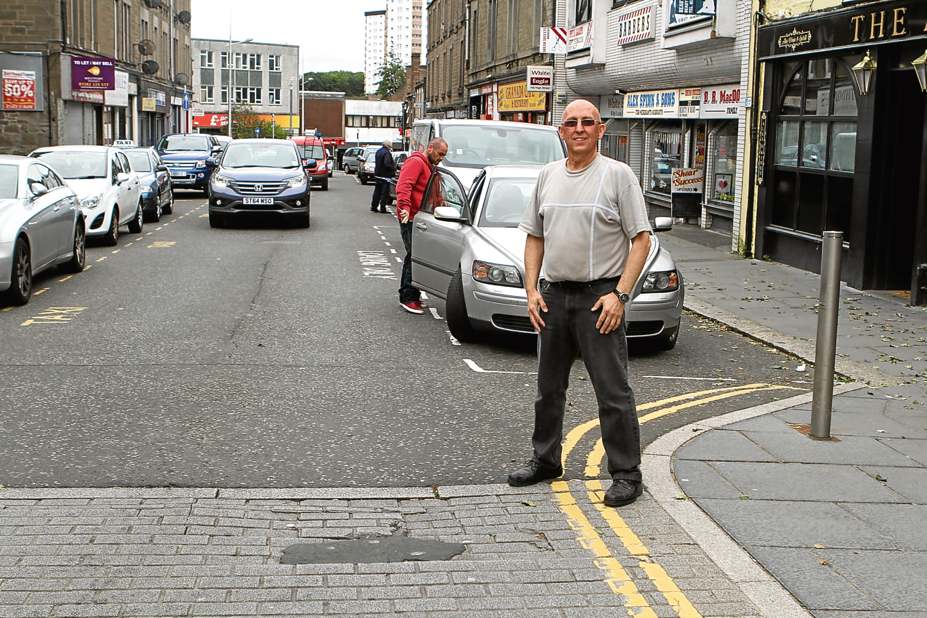 Paul Smith, the chairman of Lochee Traders' Association, pictured on the High Street. The road is set to close for four weeks later this month.