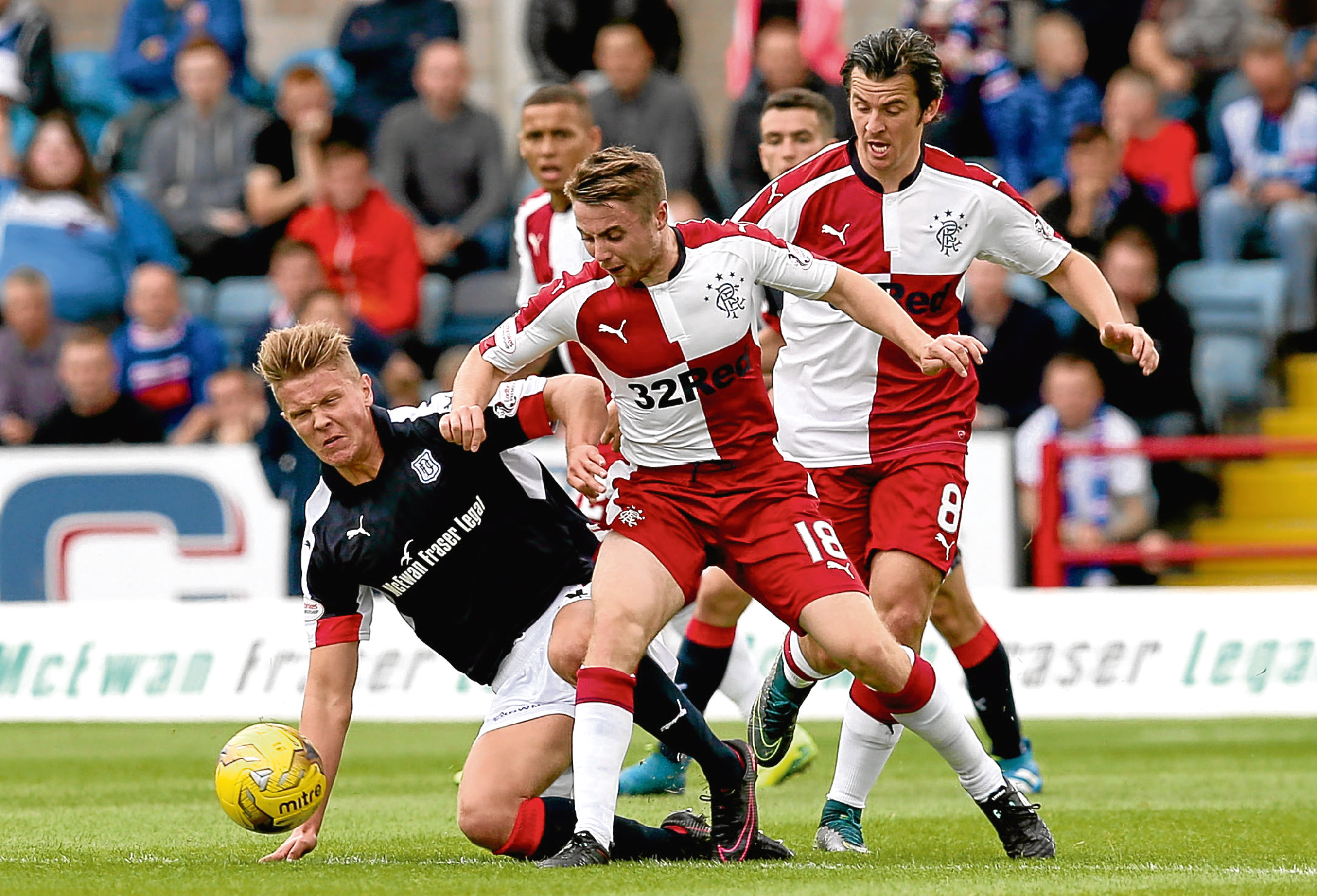 Mark O'Hara battles for the ball during the visit of Rangers in the Ladbrokes Premiership match at Dens Park on Saturday. Picture by David Young