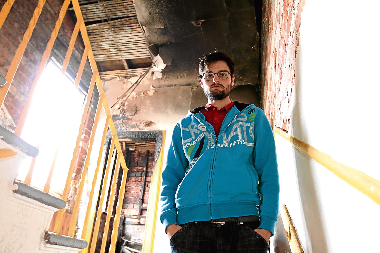 John Tasker, 21, raised the alarm after fire broke out.