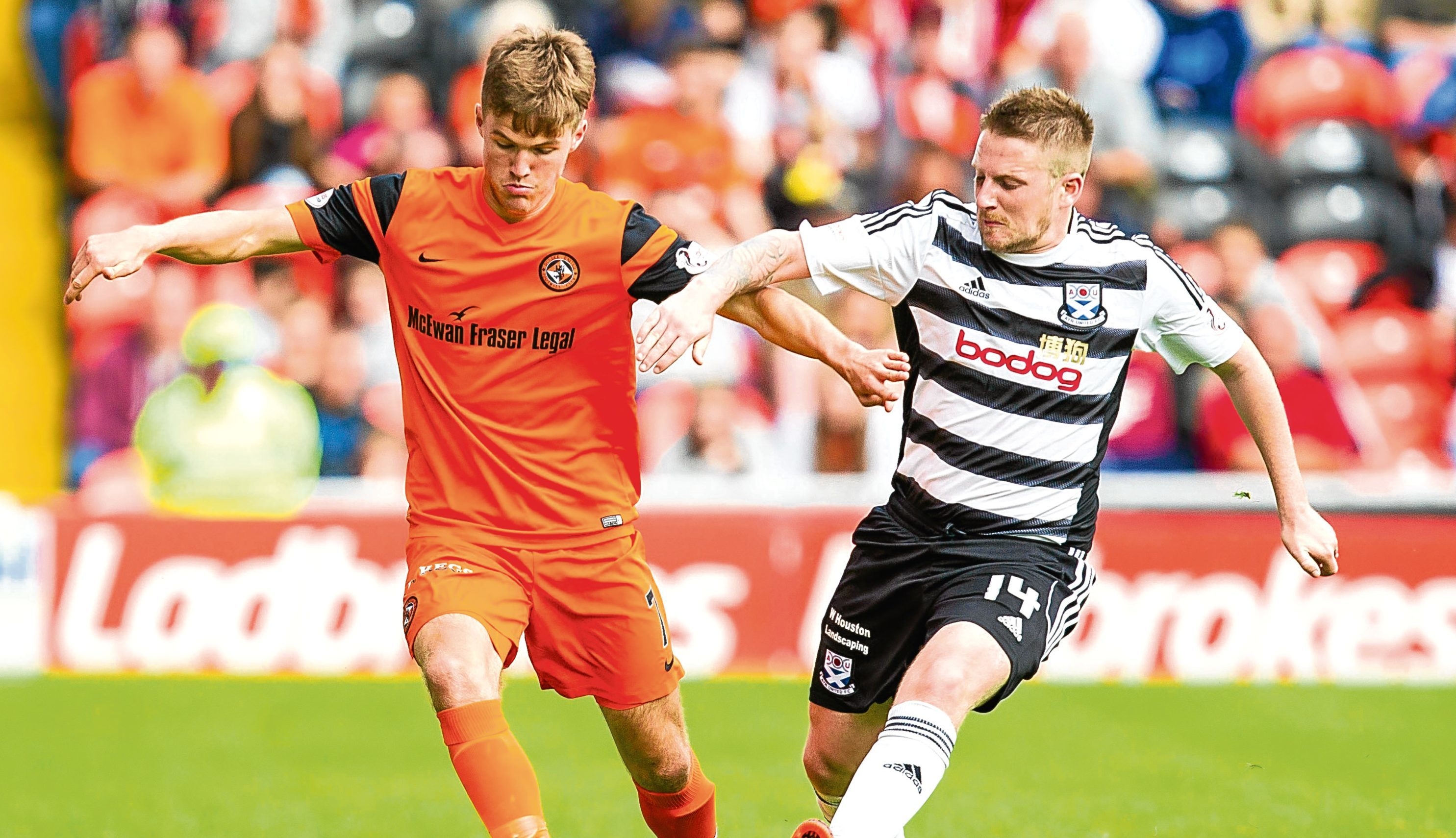 Substitute Blair Spittal battles for the ball with Ayr United's Paul Cairney as Dundee United record their first league win in the Championship.