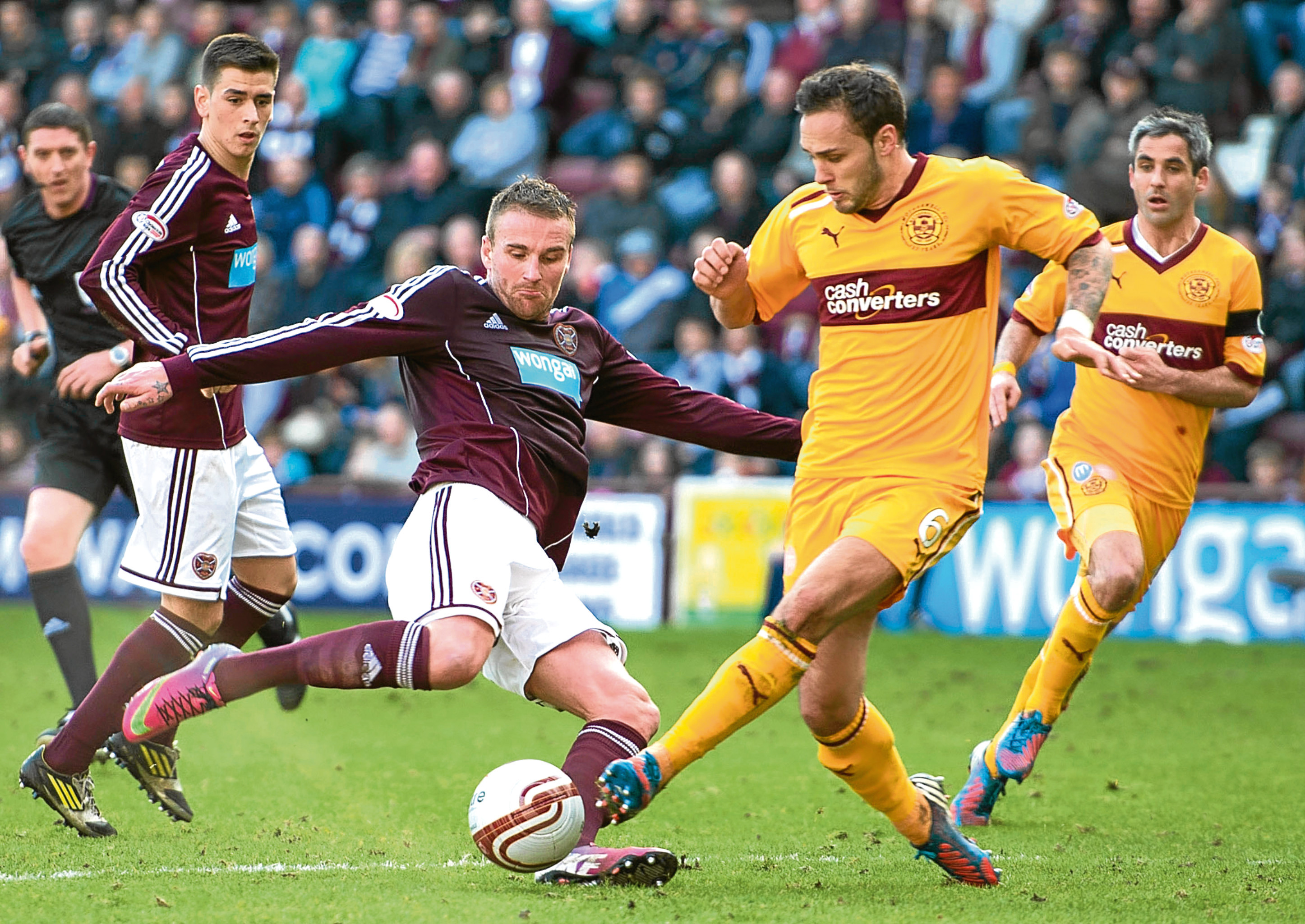 Tom Hateley, seen here while playing for Motherwell against Hearts, is still on the radar of Dundee manager Paul Hartley.