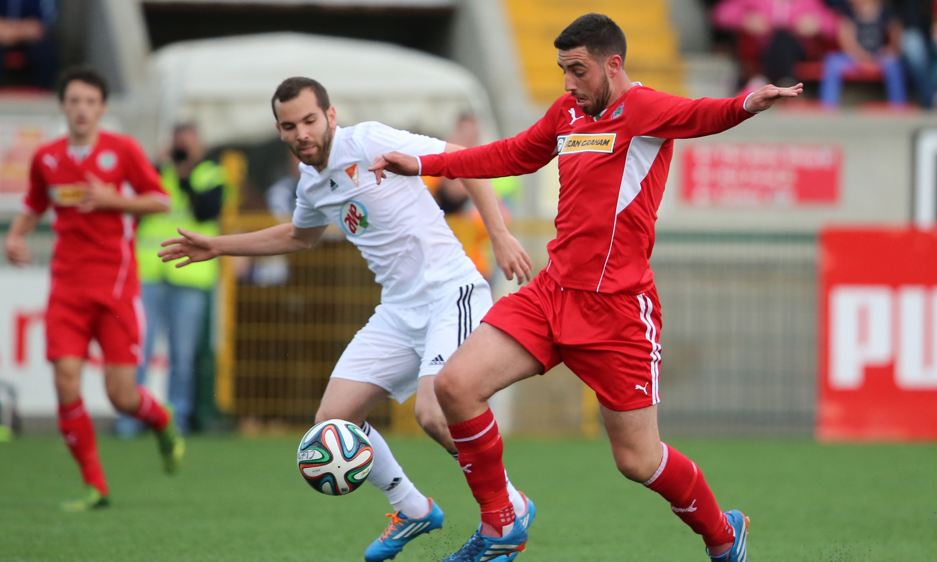 Joe Gormley (right) in action for Cliftonville in 2014.