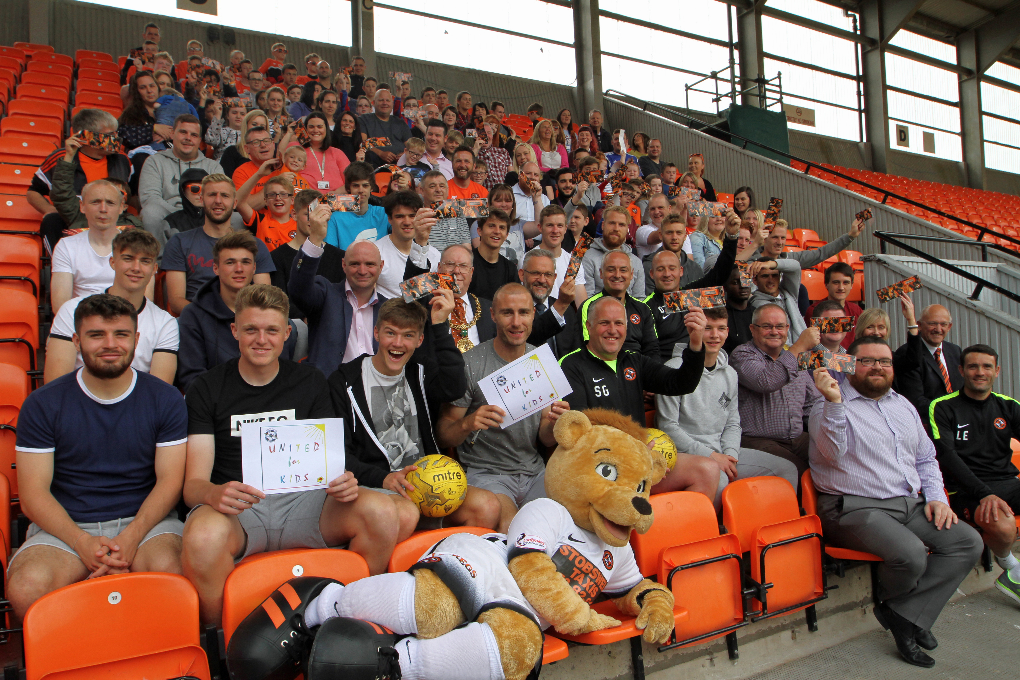 Dundee United players and staff alongside some of the recipients at Tannadice today.
