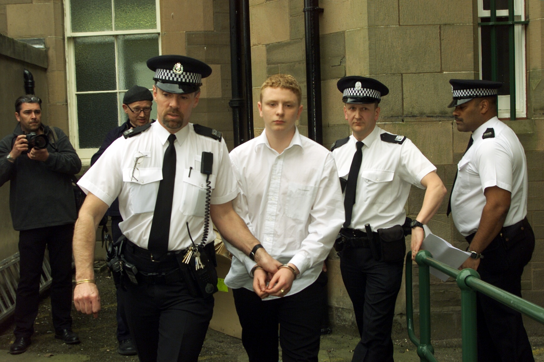 Robbie McIntosh is led away by police after his sentencing in 2002.