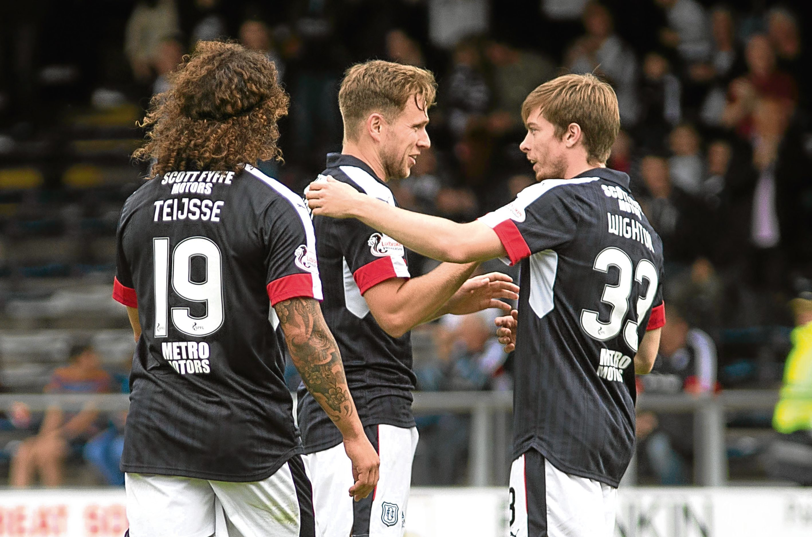 Craig Wighton and Yordi Teijsse congratulate Greg Stewart after the Dundee striker scored the fifth goal against Forfar Athletic in the Betfred Cup Group A at Dens Park in July. Picture by David Young