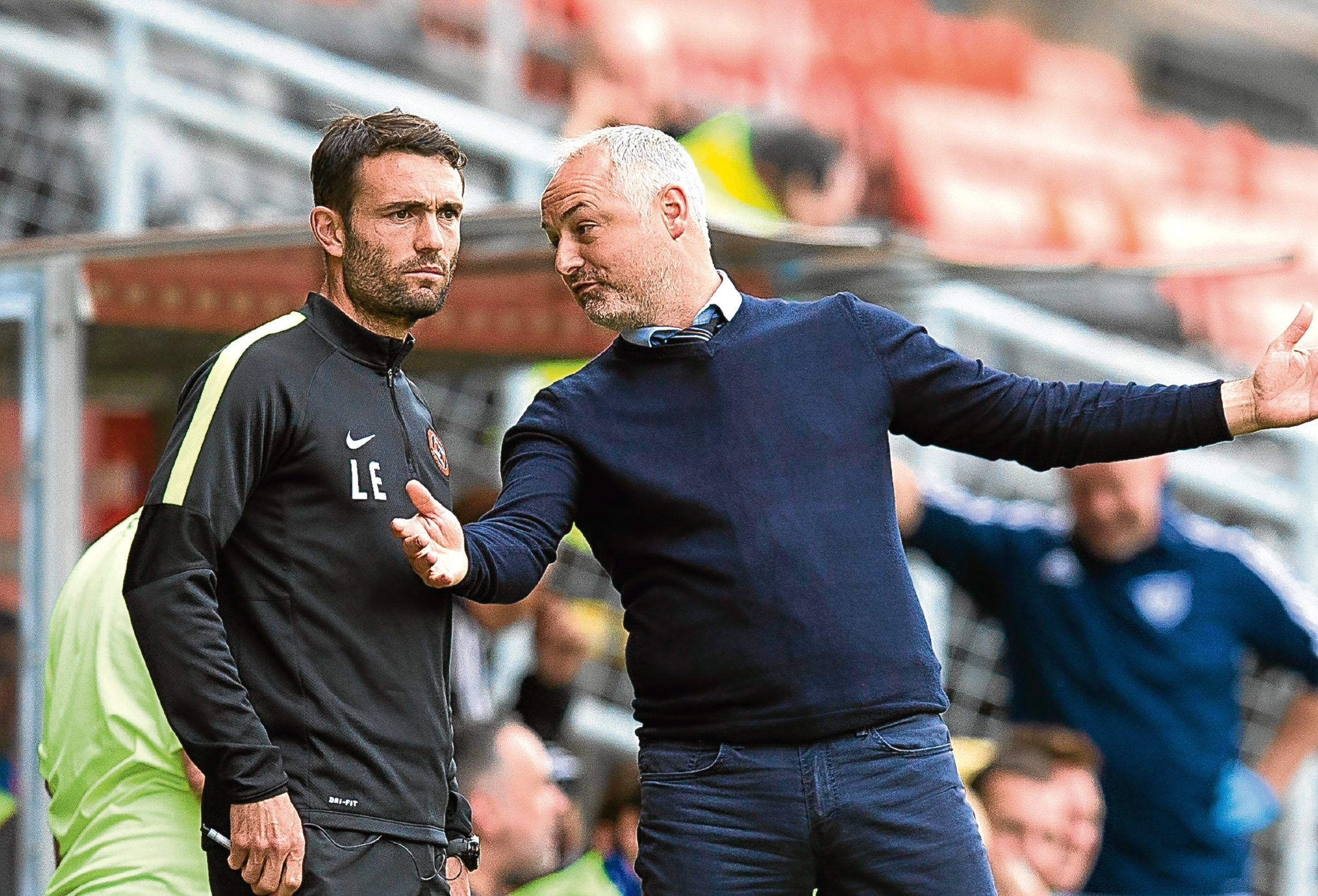 Dundee United boss Ray McKinnon (right) and his assistant Laurie Ellis