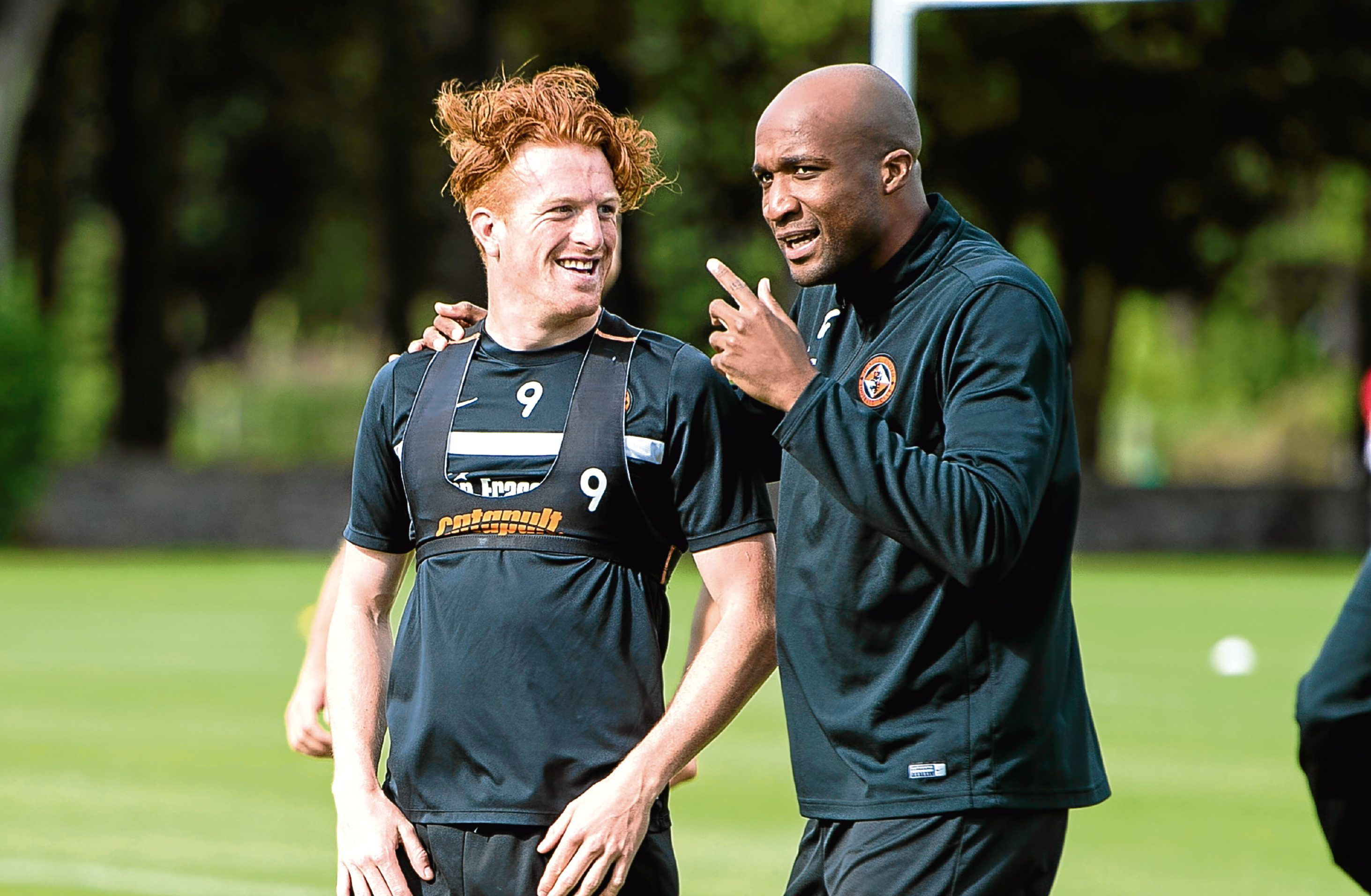 The French defender gives Simon Murray a few pointers.