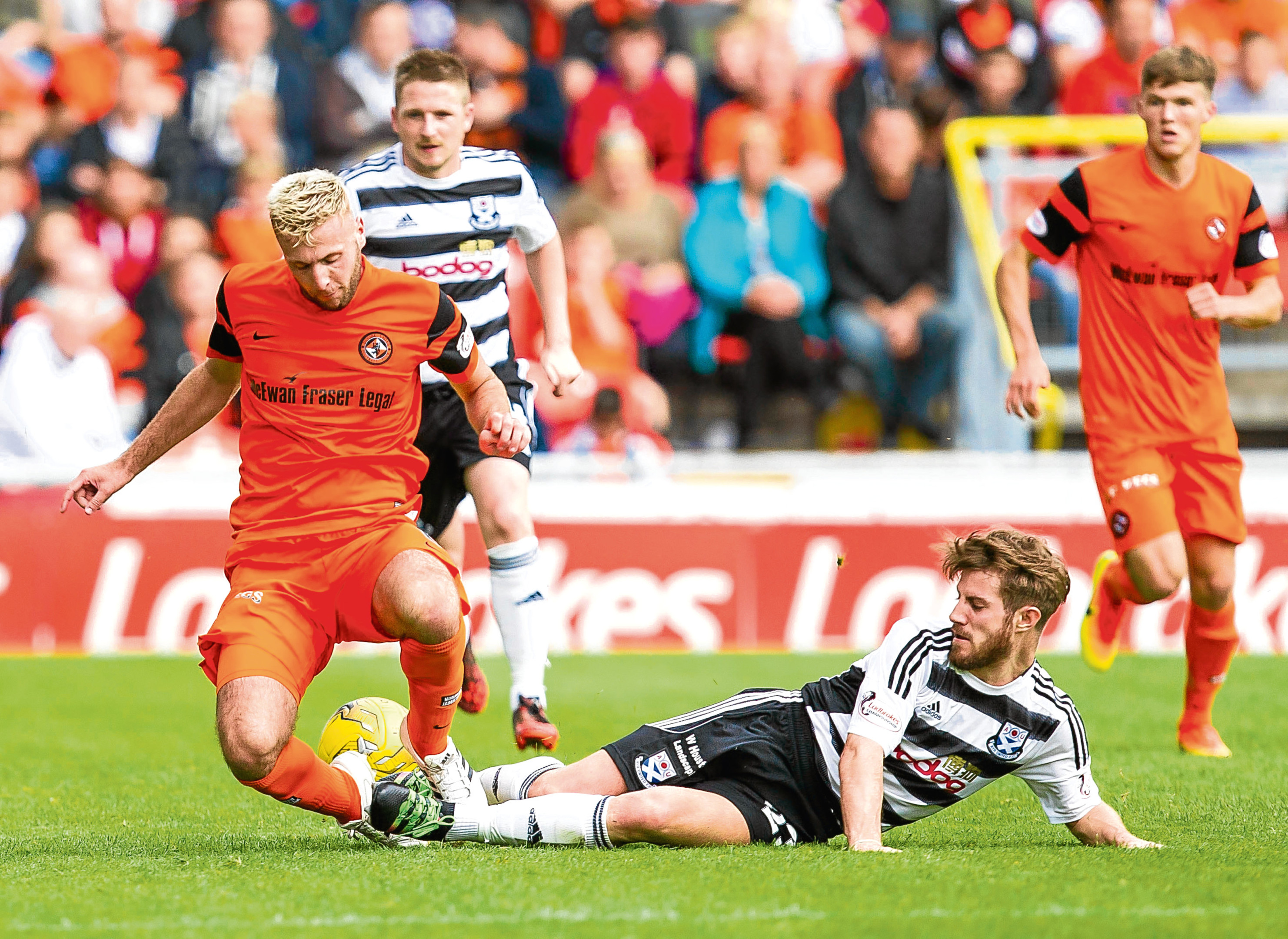 Dundee United boss Ray McKinnon is delighted with the contribution of defenders Lewis Toshney (above), Paul Dixon and Jamie Robson.