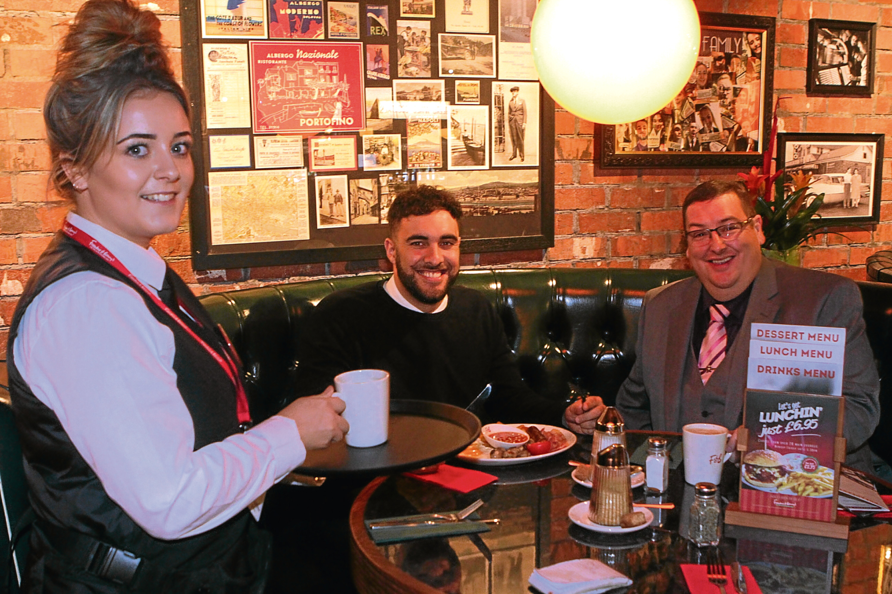 Adam Hill enjoys his breakfast served by Rebecca Cree and  general manager Andy Duthie