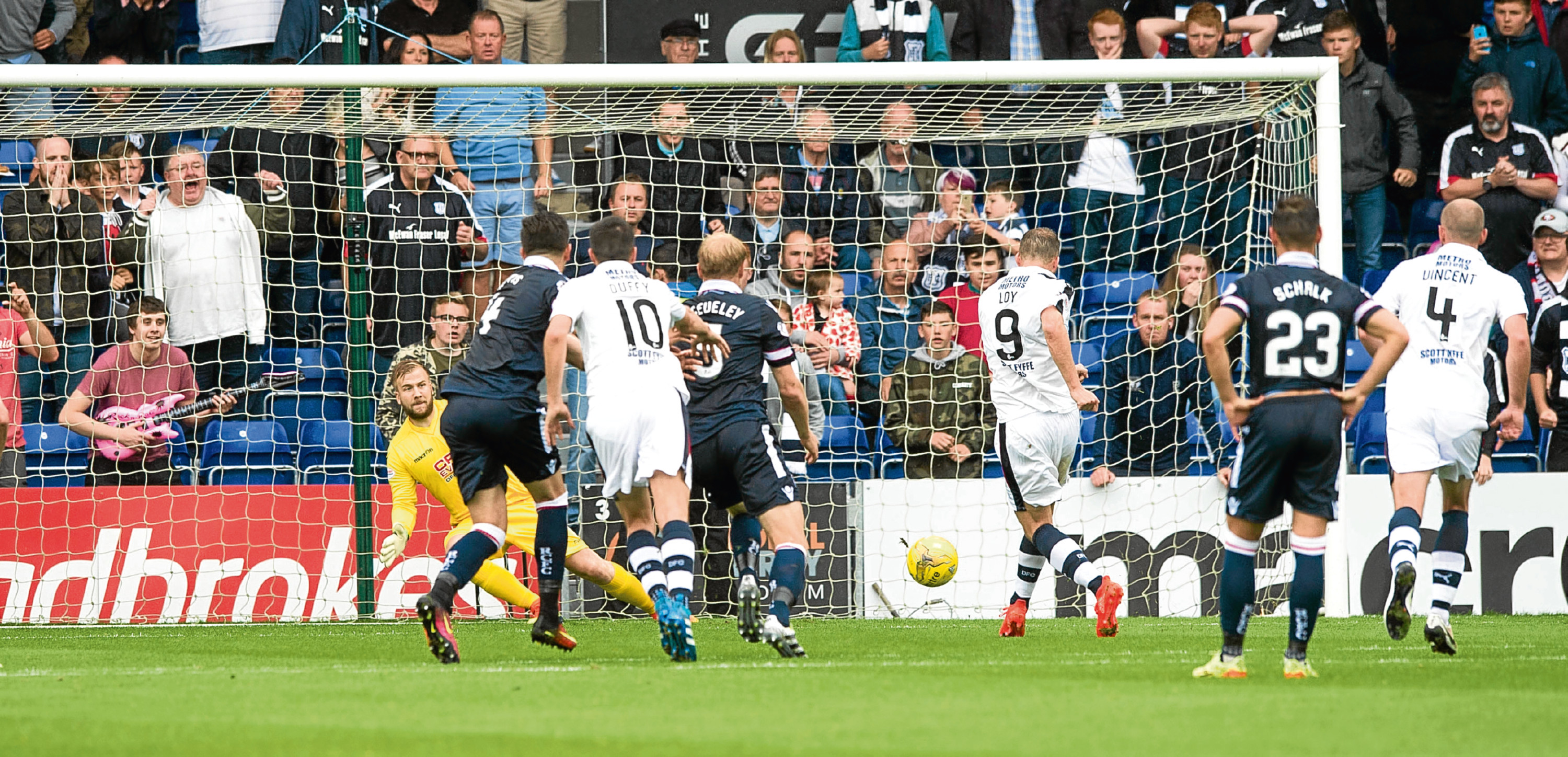 Rory Loy struck twice, once from the penalty spot (above), as Dundee beat Ross County 3-1 on the opening day of the league season in Dingwall.