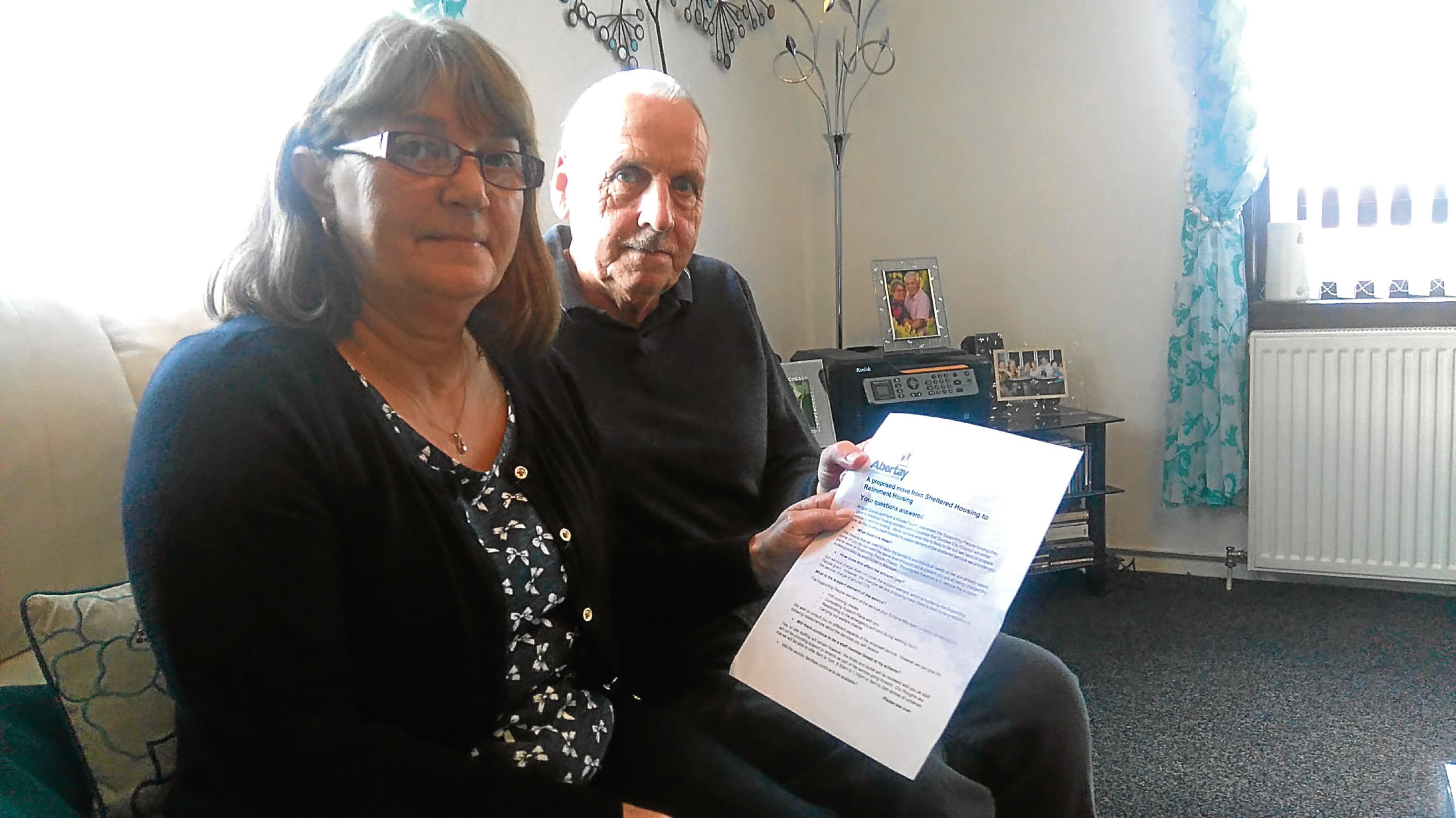 Brian and Katherine Perrie with a copy of the letter from AHA.