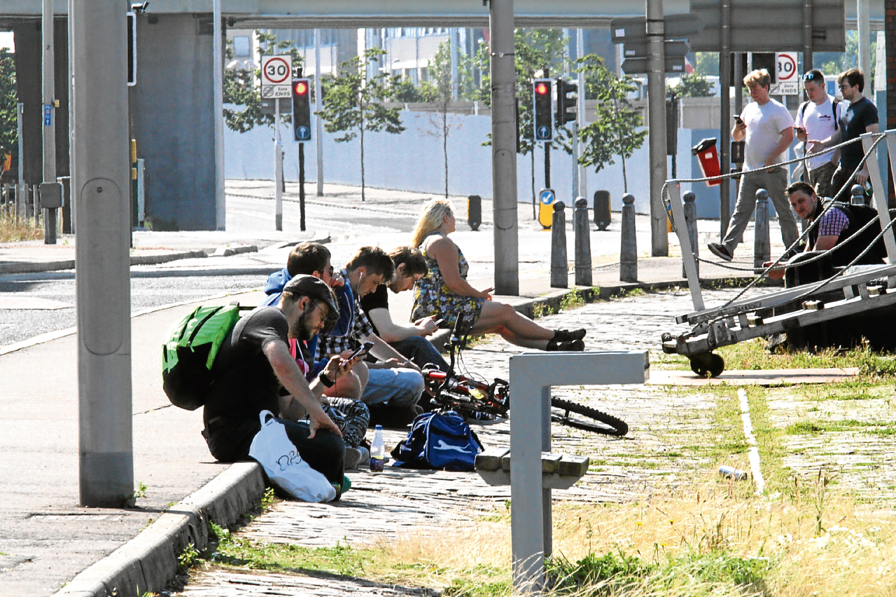 Pokemon Go fans pictured playing the hit game at City Quay in Dundee.