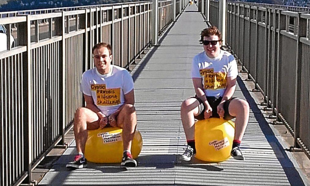 Greg Beckett and Ewan Gray on the Tay Road Bridge on Sunday, raising money for the Cystic Fibrosis Trust.