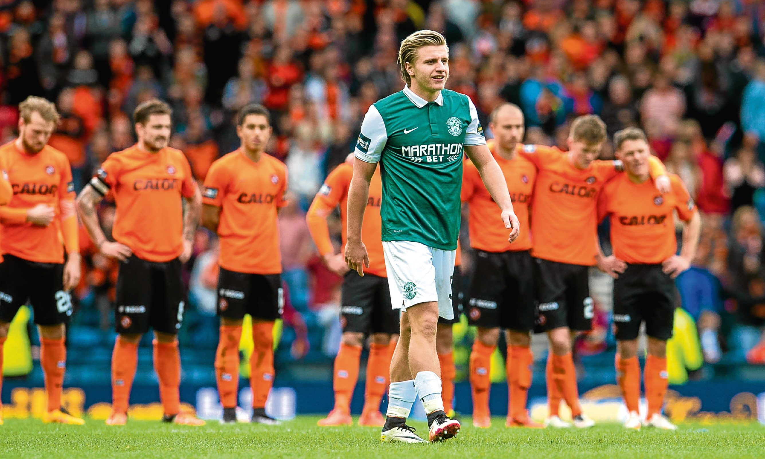 Dundee United were dumped out of both the League and Scottish Cup by Hibs last season. Pictured is Hibs striker Jason Cummings stepping up to take the winning spot-kick at Hampden in April.
