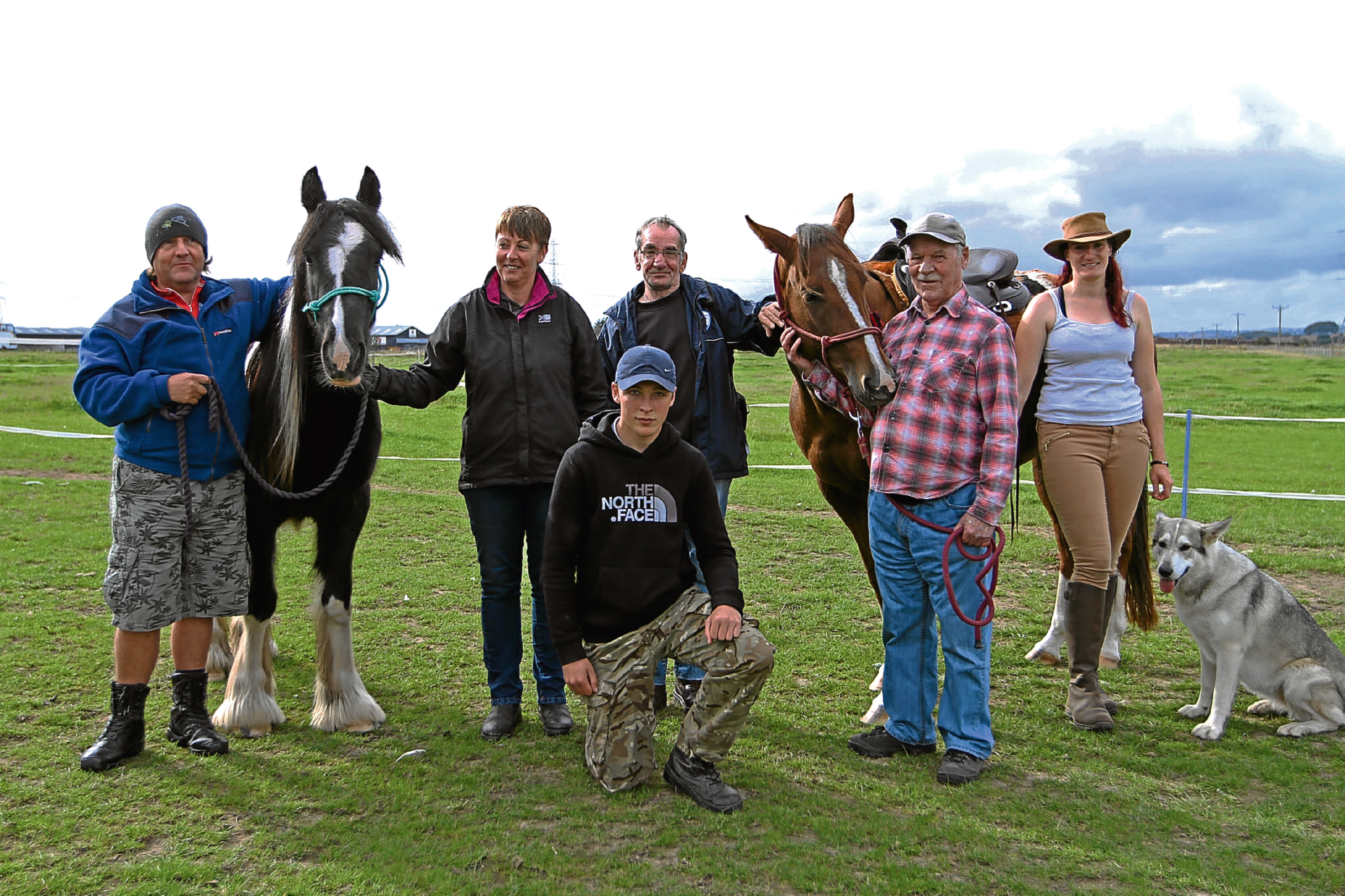 Tommy Hays, Sammy, Alison Dunlop (trustee of the charity), John Millar, Spice, John Byrne, Jessica Probst (founder of the charity) and, front, Timo Condie.