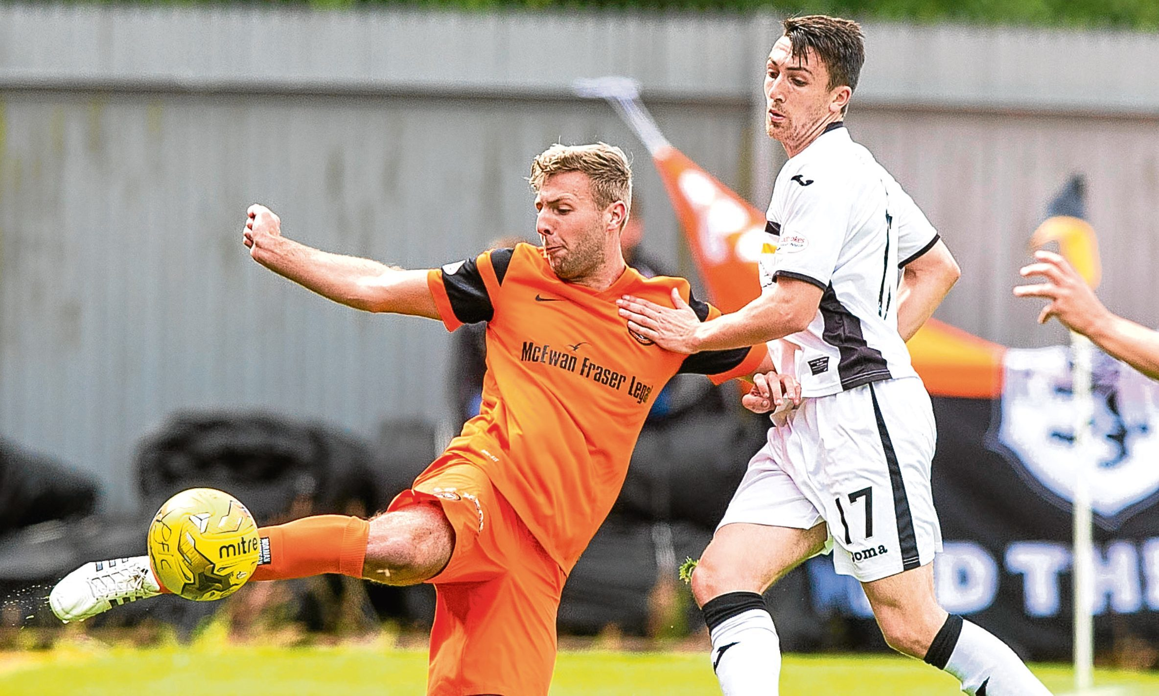 Dundee United defender Lewis Toshney (pictured in action against Dumbarton) knows a visit to Easter Road will be no easy task, with Hibs desperate to get back to top-flight football next season.