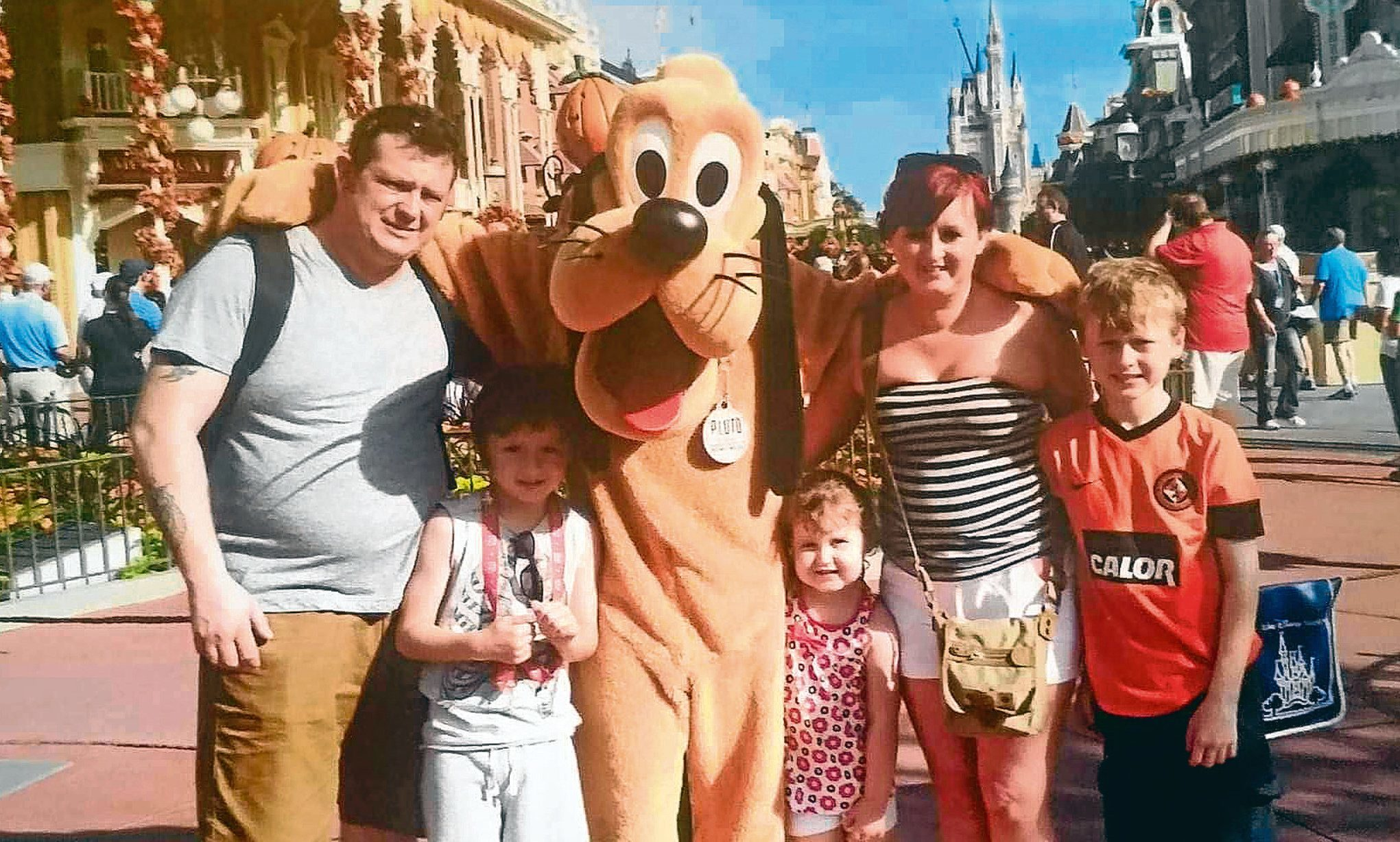 Lee with the family on the Disney World holiday
