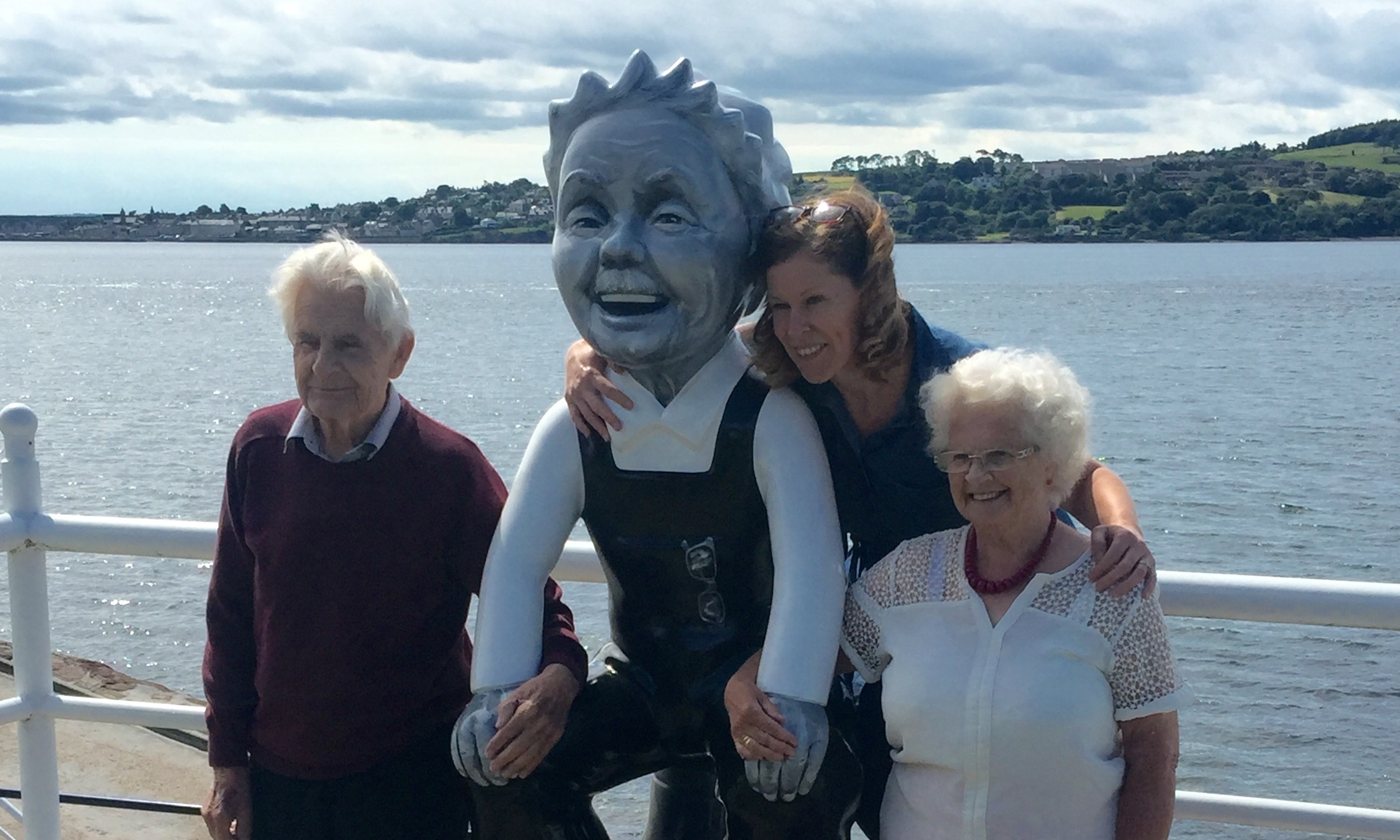 Raymond Mennie (left) and Barbara Clubb (right) who Oor Wullie Noo was modelled on alongside artist Alison Price.