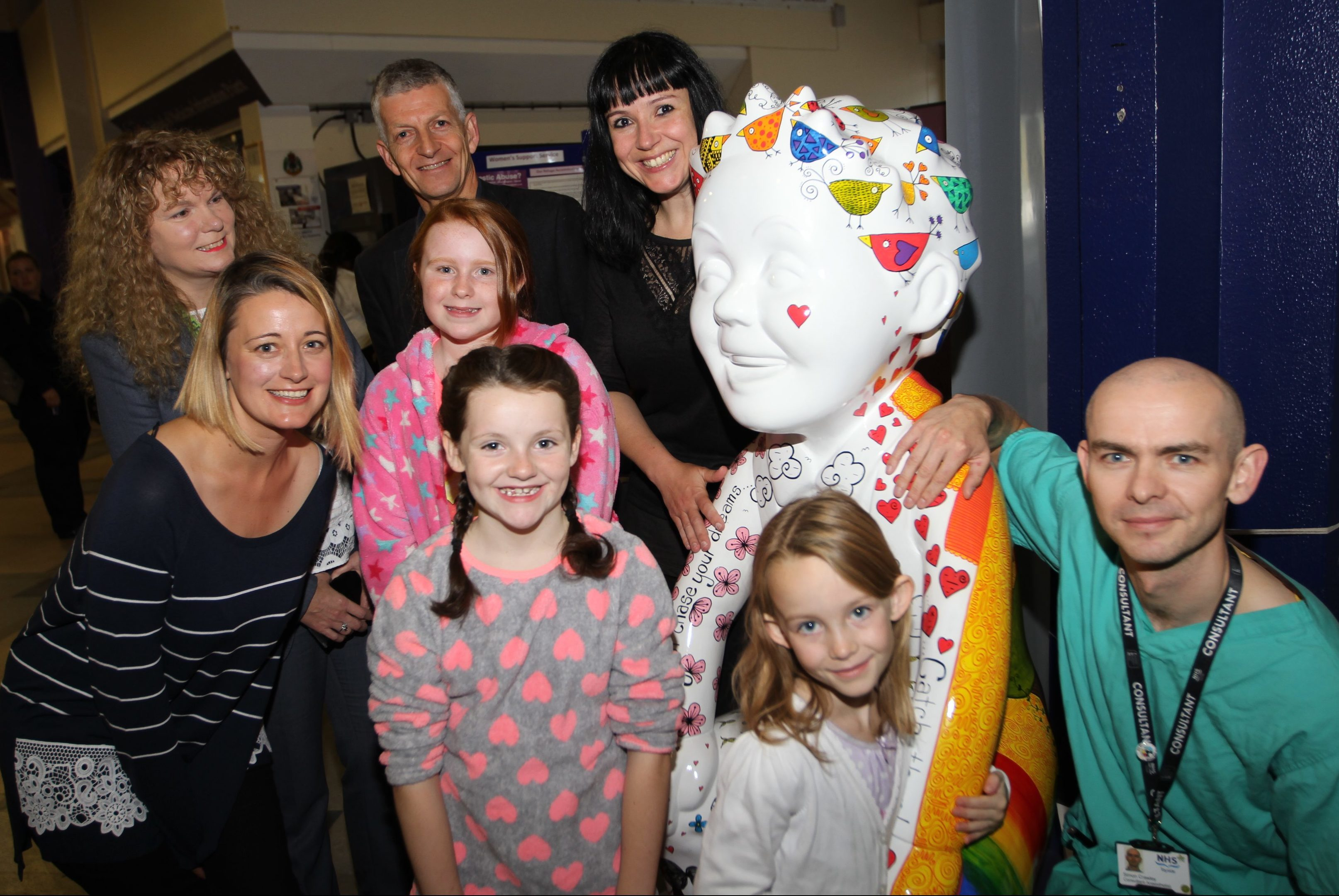 Clockwise, from left: Archie Director of Fundraising Cassie Thompson, NHS Tayside Chief Operating Officer Lorna Wiggin, consultant anaesthetist Dr Grant Rodney, artist Suzanne Scott and Dr Simon Crawley with child patients from Ninewells.