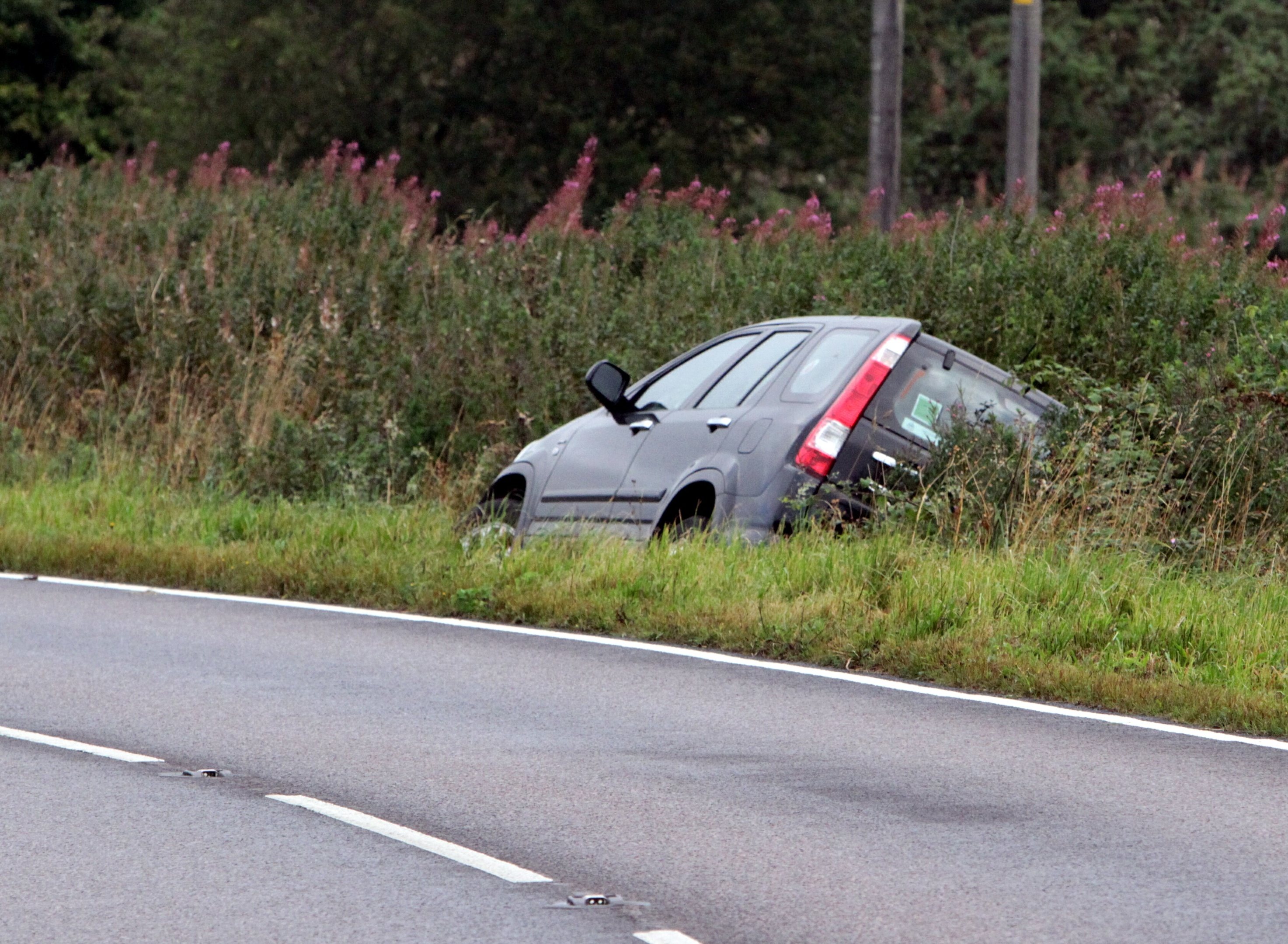 The car at the side of the road.