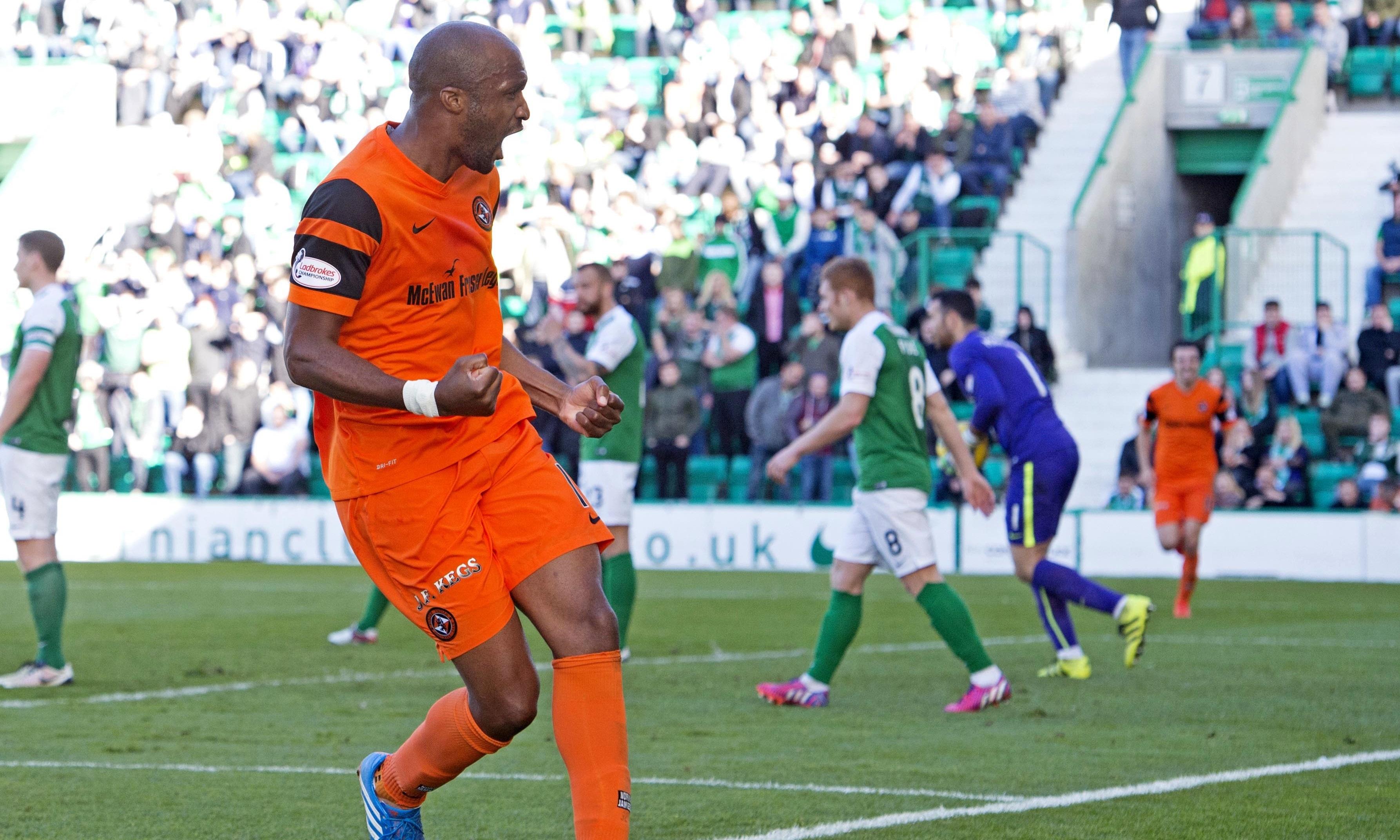 William Edjenguele after levelling the scoring for Dundee United