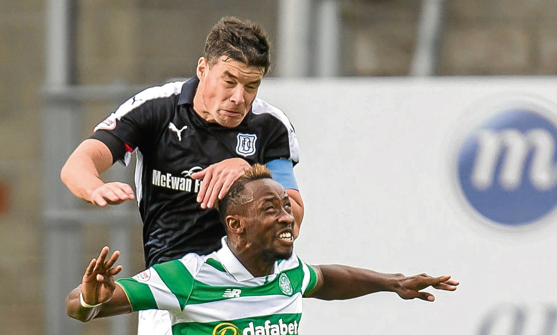 Darren O'Dea outjumps Celtic's Moussa Dembele at Dens on Saturday. Picture by David Young