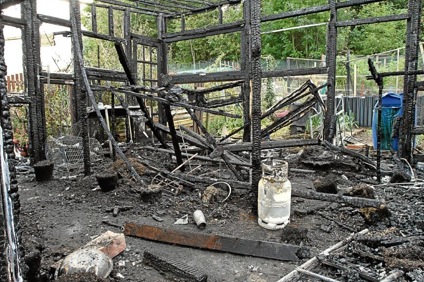 The burnt-out greenhouse.