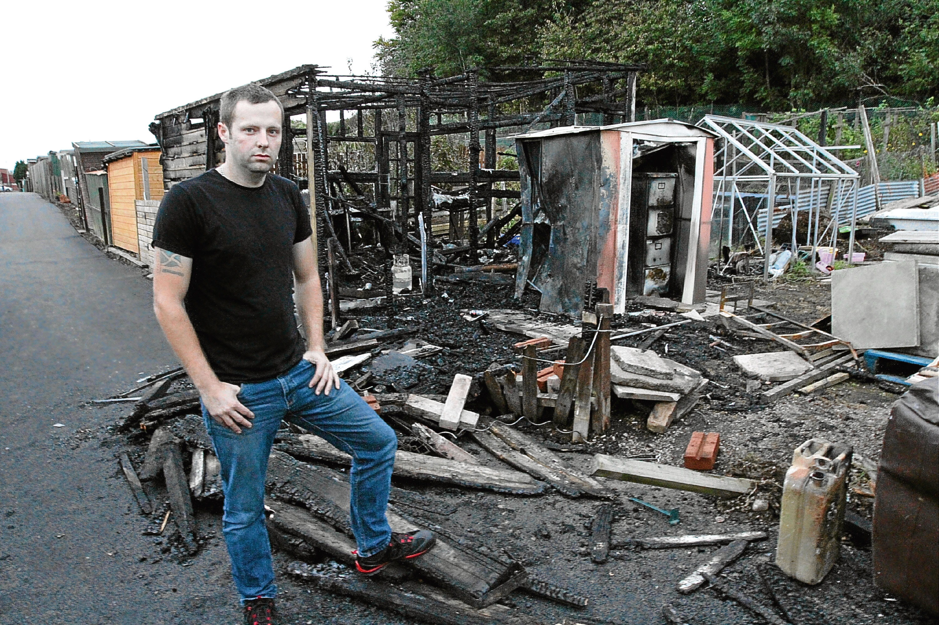 Peter Chalmers at the scene of the allotment blaze.