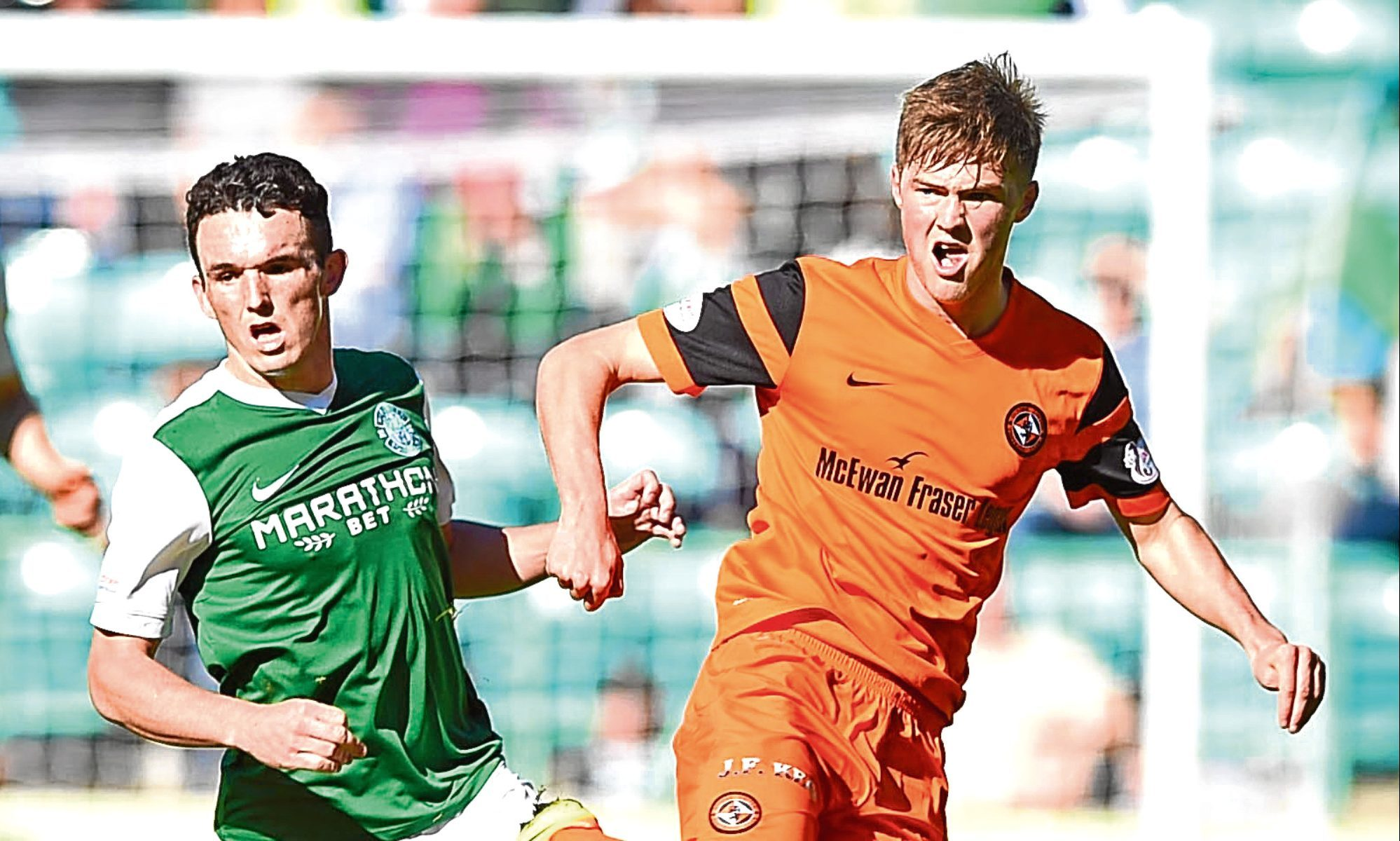 Dundee United's Blair Spittal and Hibs' John McGinn keep their eyes on the ball during last weekend's hard-fought Championship draw at Easter Road.