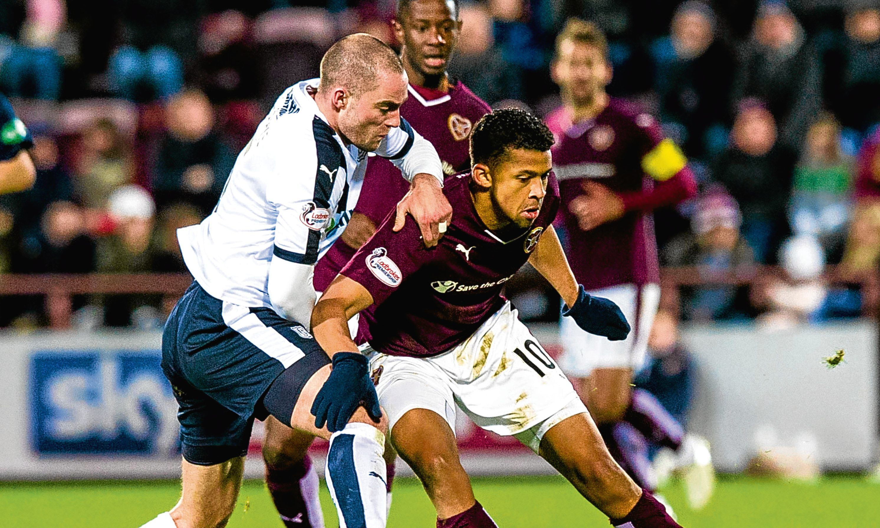 Dundee captain James McPake battles for the ball with Osman Sow at Tynecastle in the Dark Blues only point against Hearts last term.