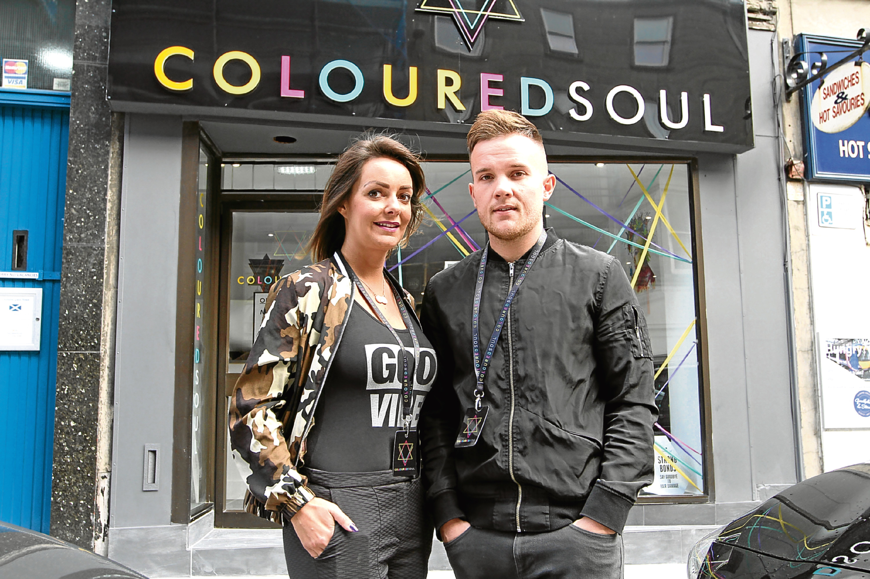 Gemma Slade with Rhys Davidson outside their new salon in the city centre, where they will hold their fundraising event this weekend.