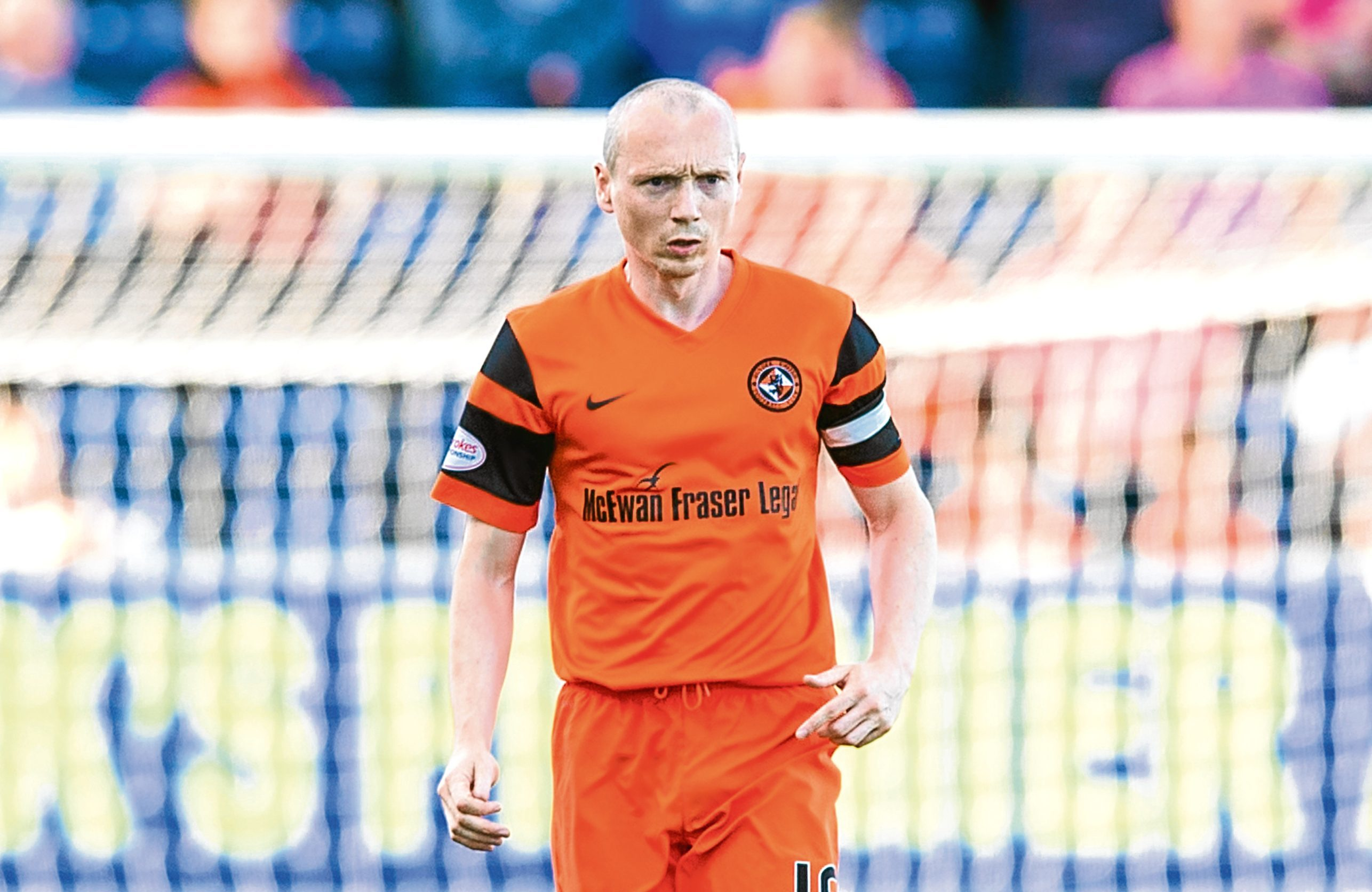 Dundee United's Willo Flood in action