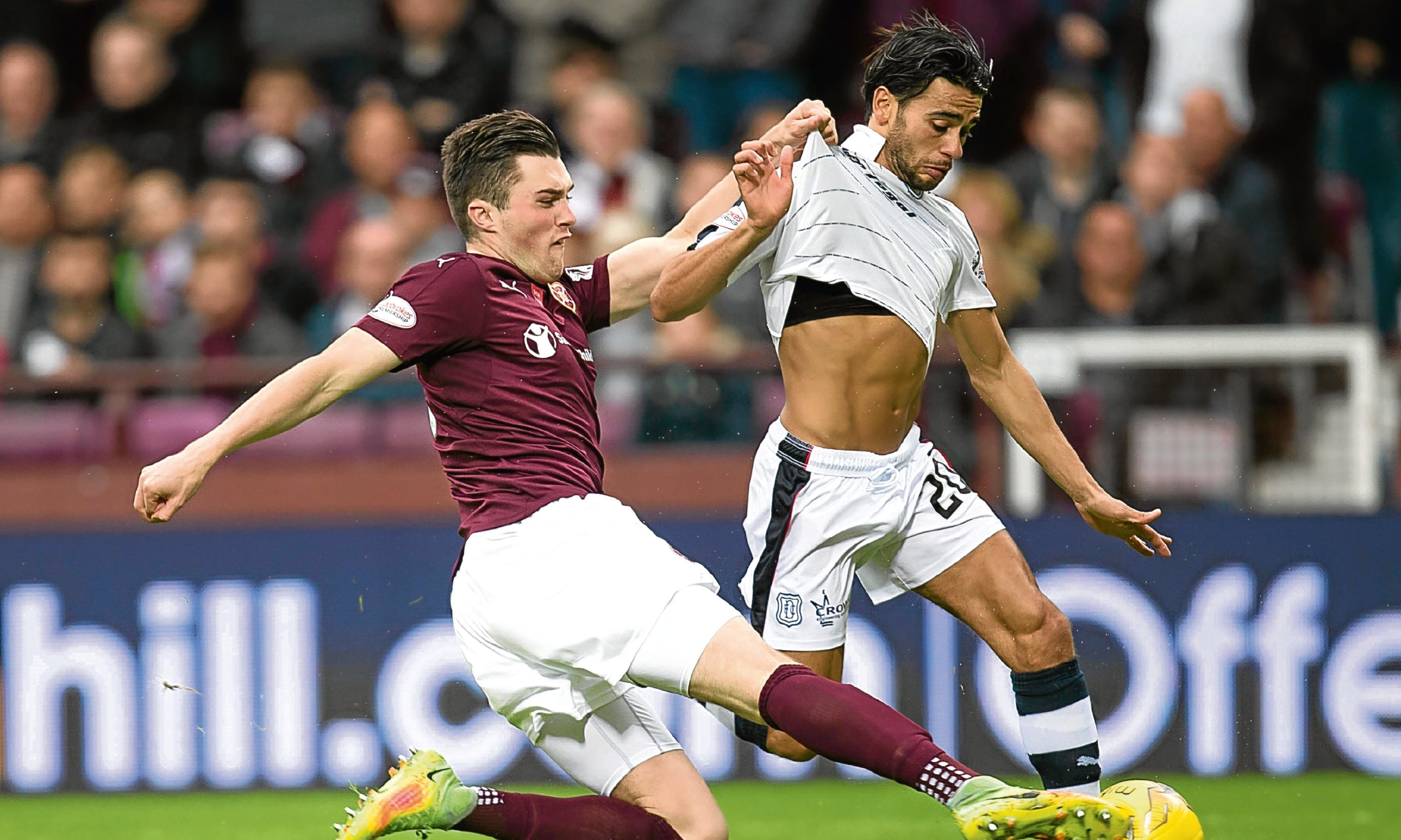 Hearts'' John Souttar tackles Dundee''s Faissal El Bakhtaoui during Saturday's game.