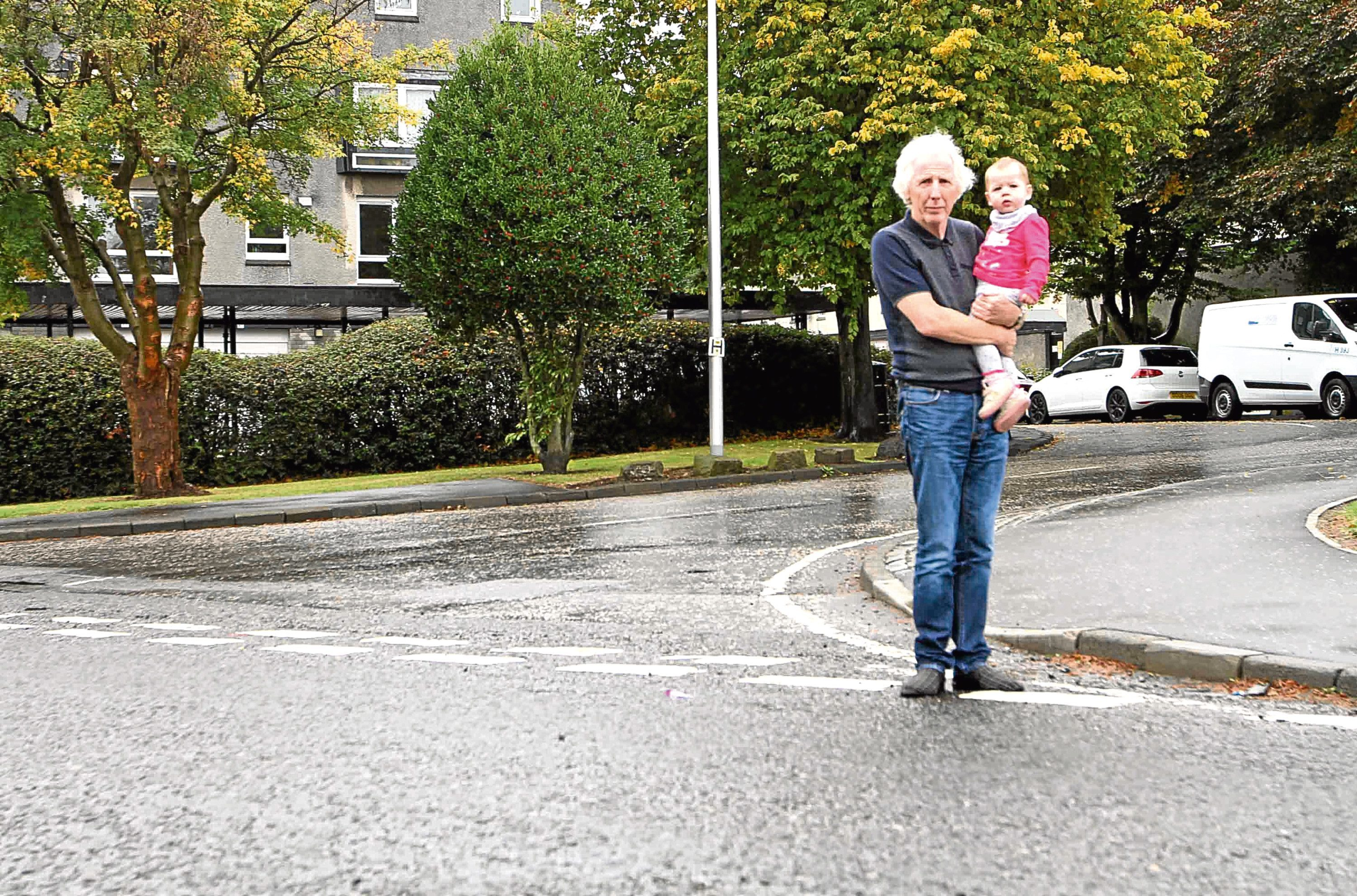 Michael Markie, 65, and his one-year-old granddaughter Ameile Ritchie at the junction.