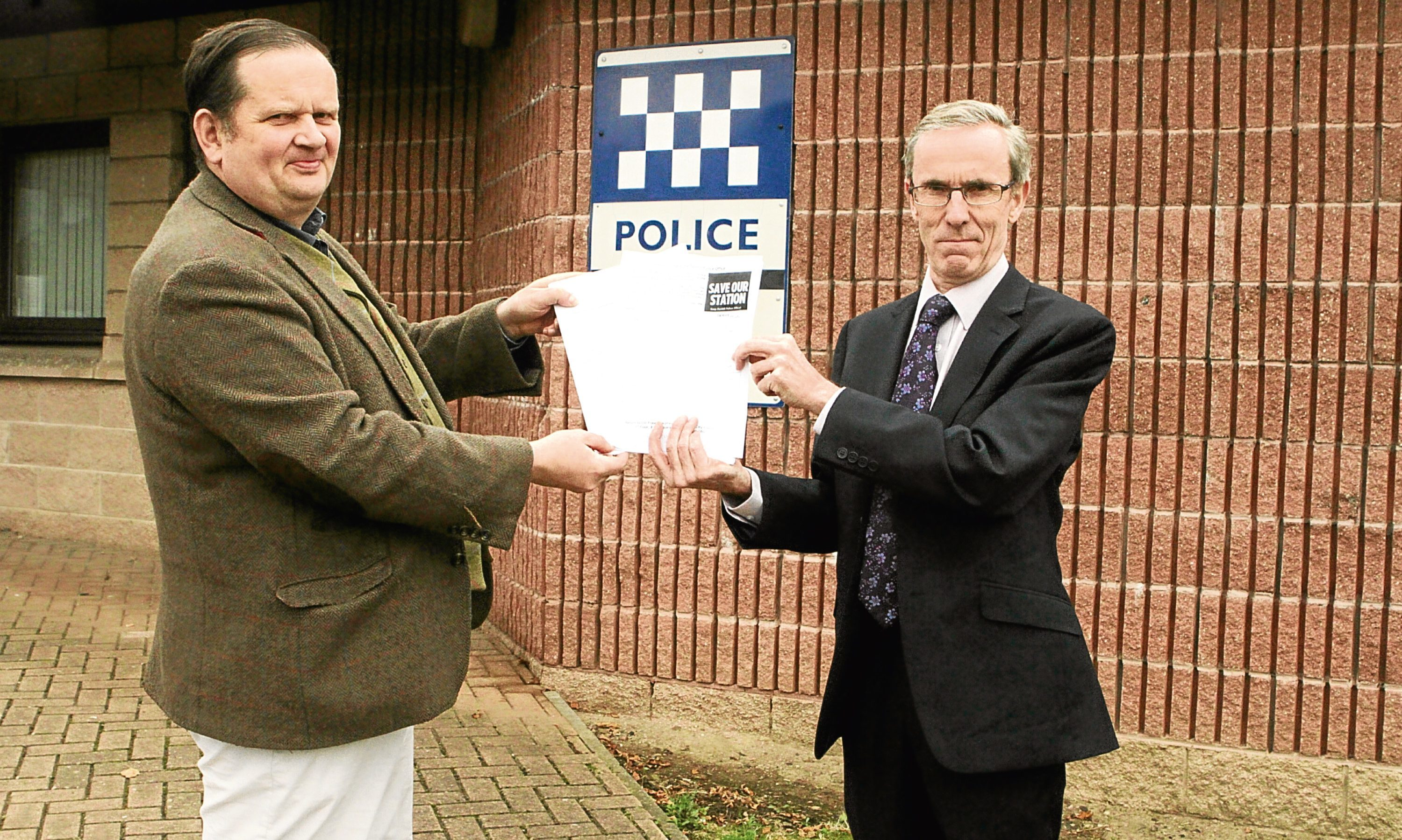 Peter Menzies, chair of West End Community Council, and Councillor Fraser Macpherson handing in the petition.