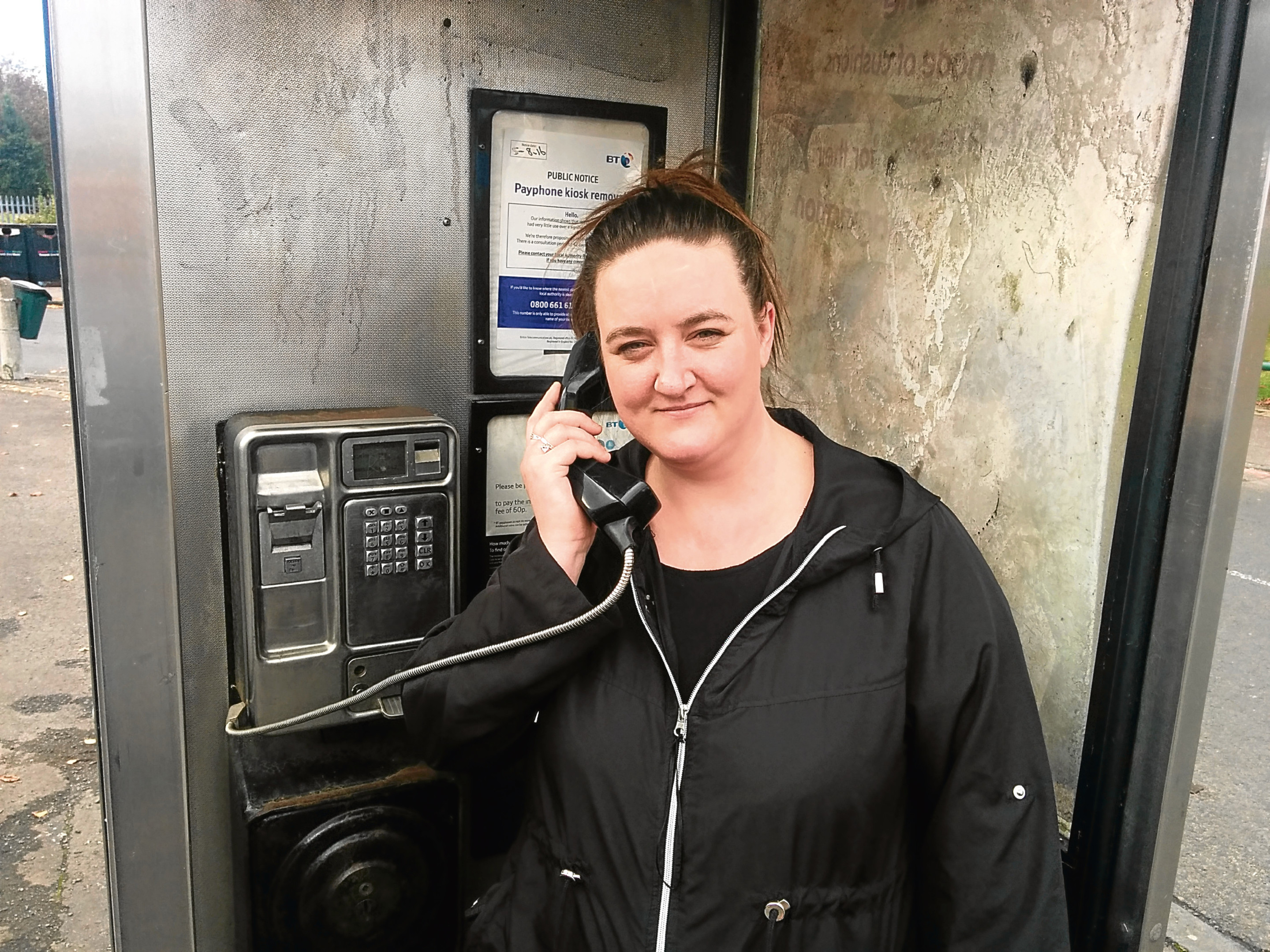 Kelly Airlie in one of the citys phone boxes.
