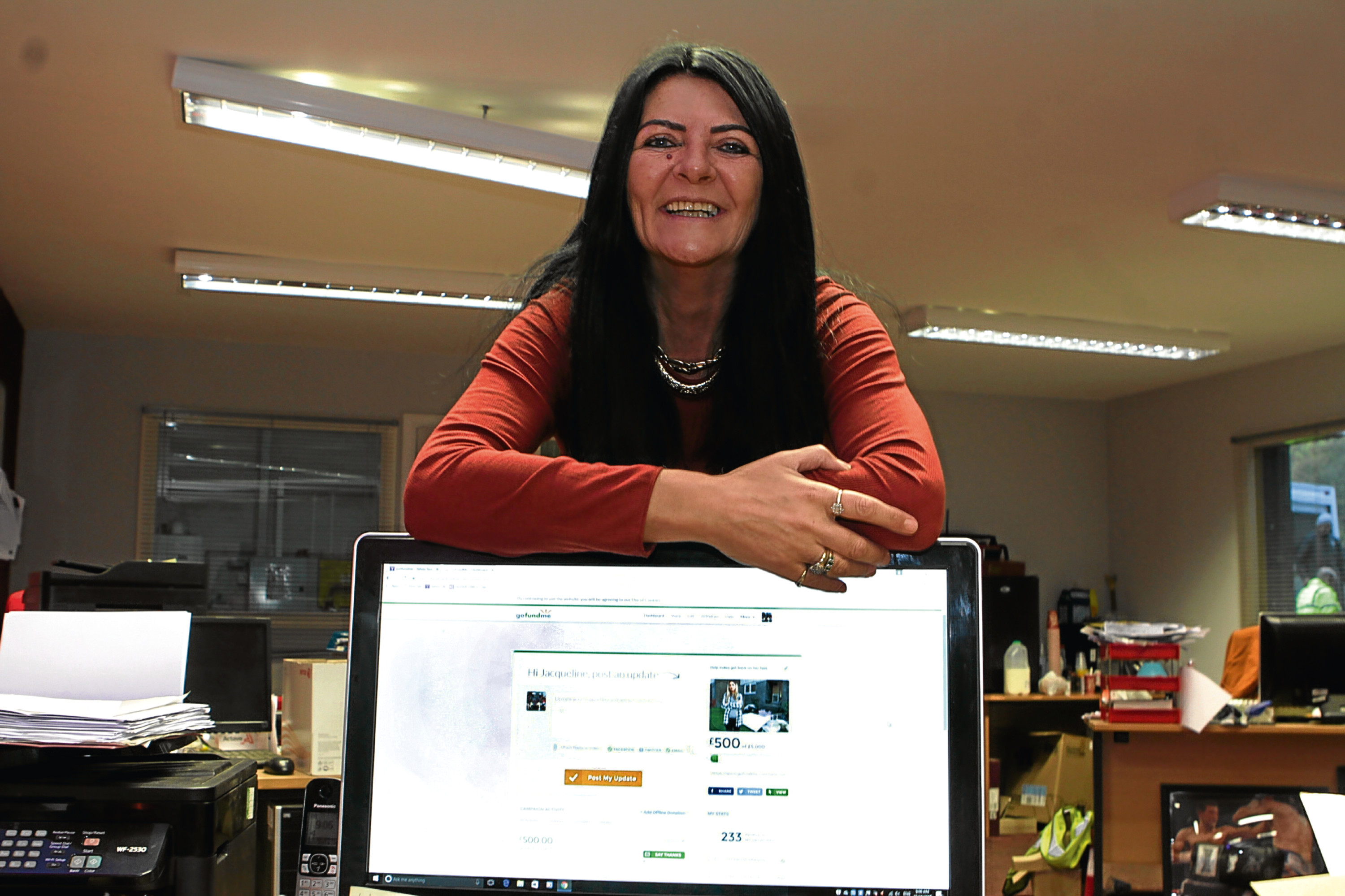 Jackie Bryceland shows off the fundraising page she has started.