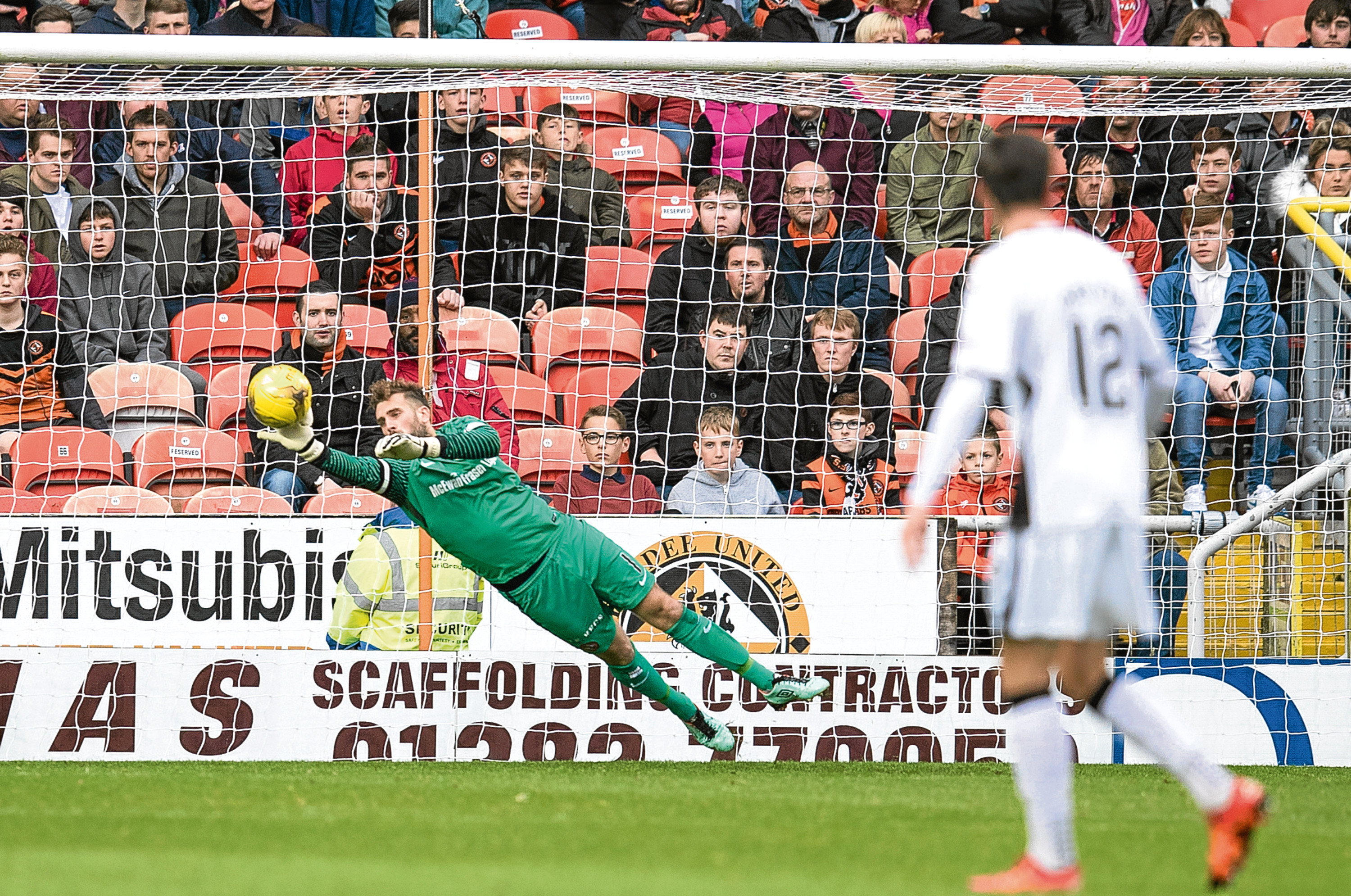 Tangerines' No 1 Cammy Bell pulls off yet another fine save to deny visitors Dumbarton in last weekend's 2-1 win which propelled his side to second in the Championship.