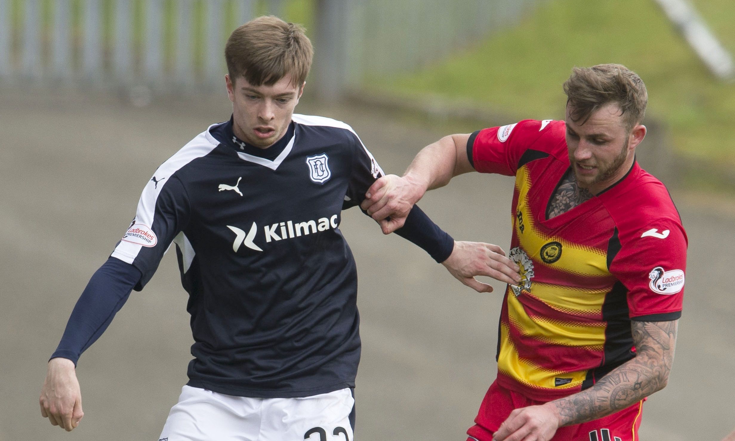 Dundee's Craig Wighton tussles with Christie Eilliott of Partick in a clash last season.