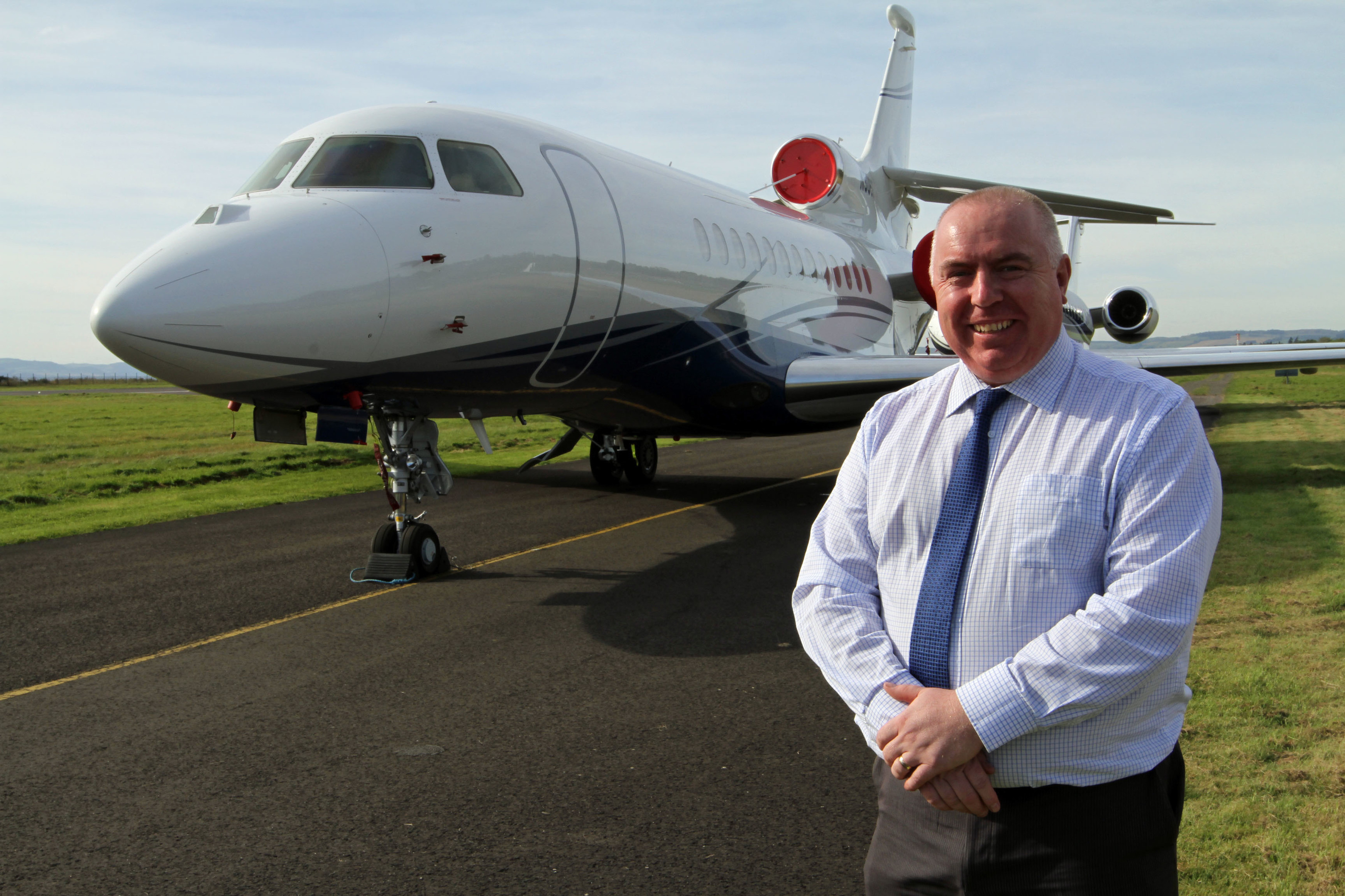 Dundee Airport manager Derrick Lang beside one of the jets.