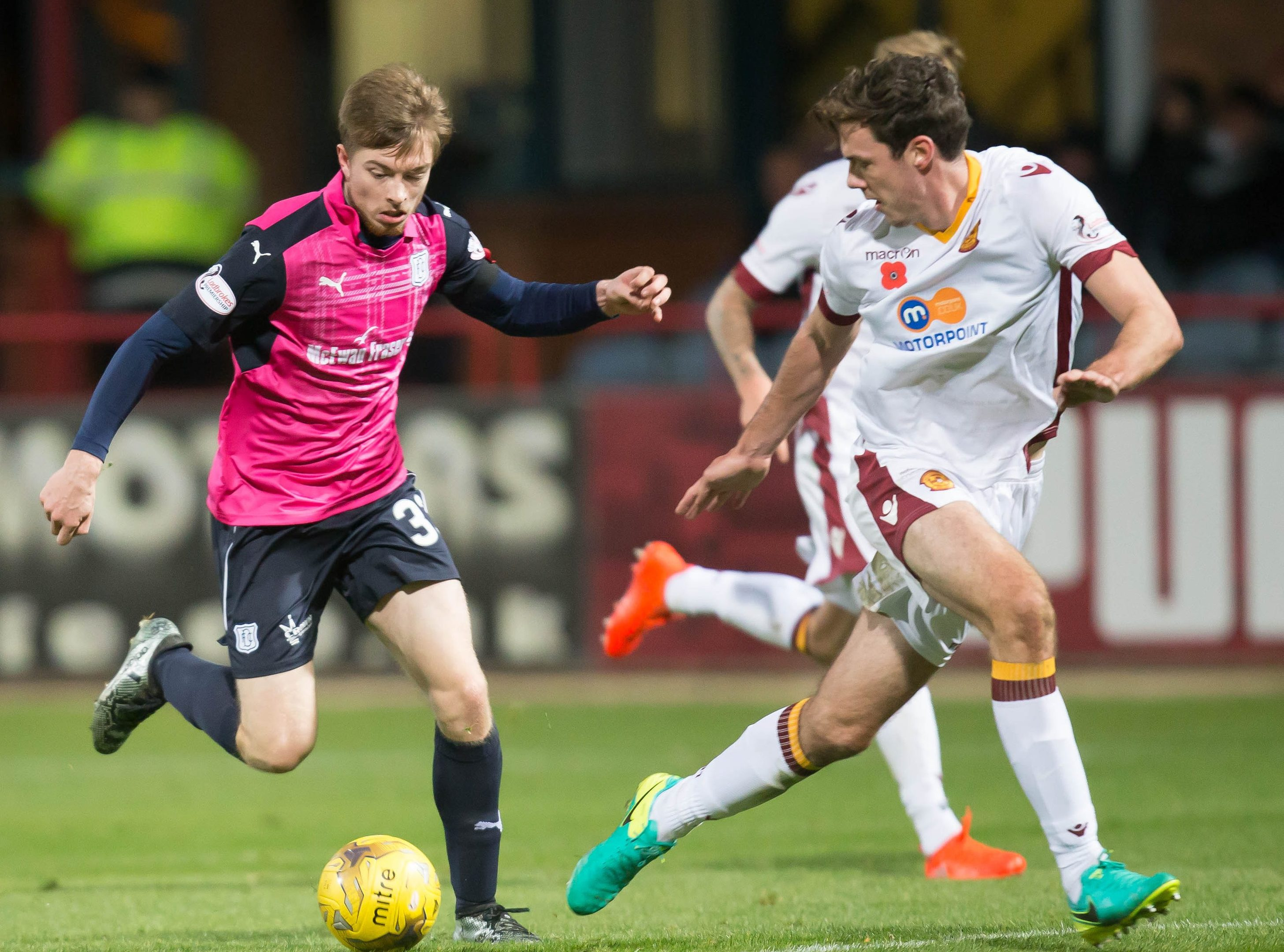 Craig Wighton drives at the Motherwell defence.