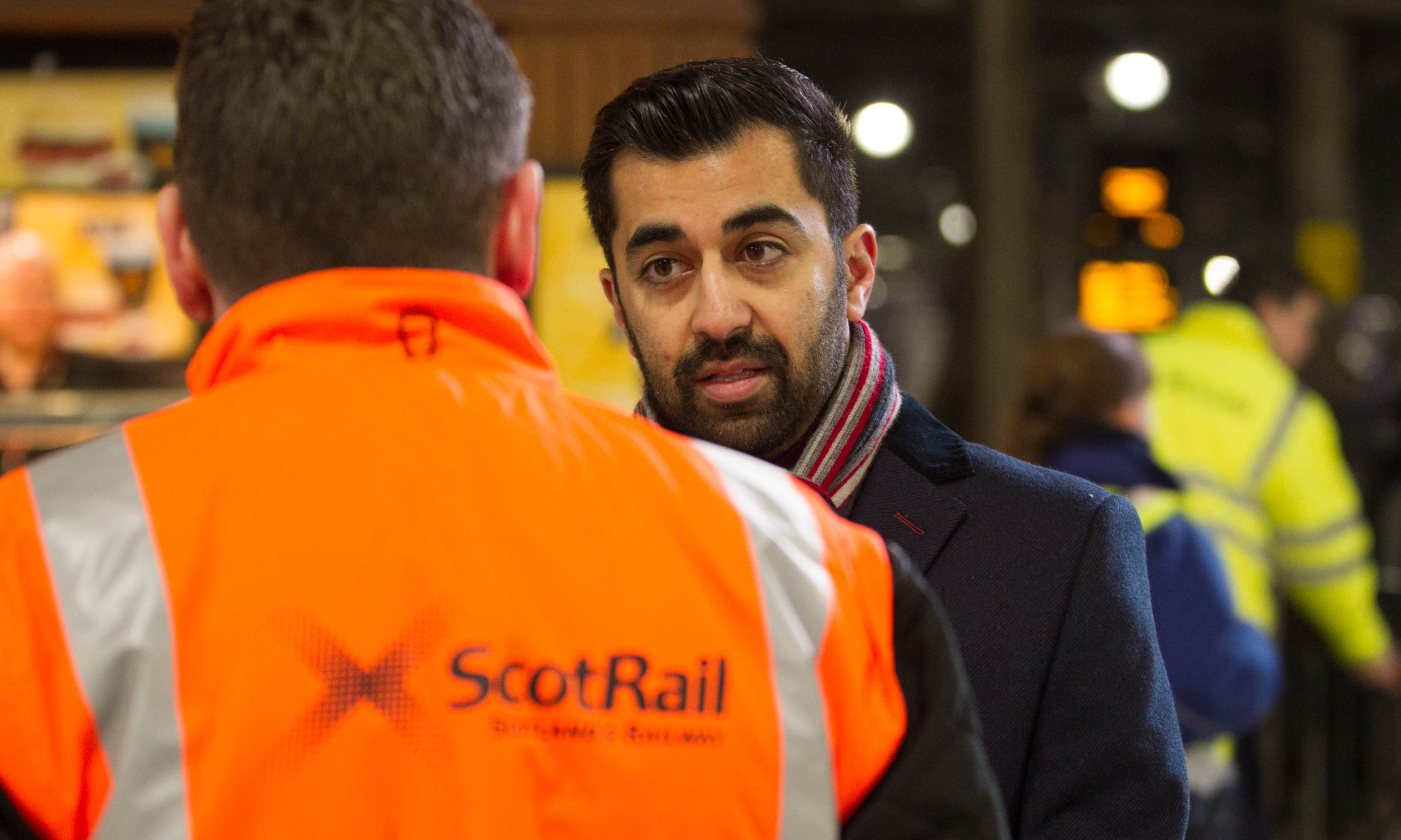 Transport Minister Humza Yousaf speaks with a ScotRail worker at Glasgow's Queen Street Station last week.