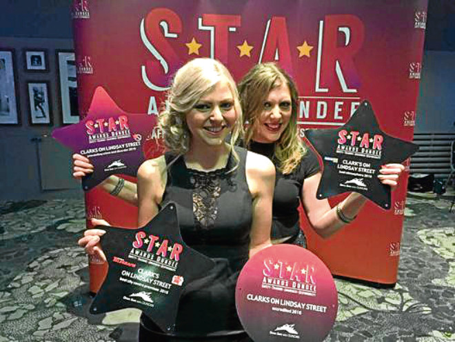Lisa and Katie from Clarks with their haul of awards.  Picture by Jon Gill, @OnTheSuperfly