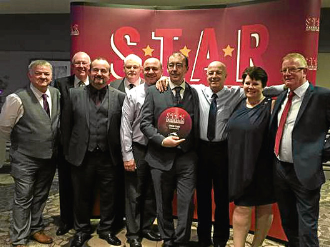 Staff from the Logie Club with their award