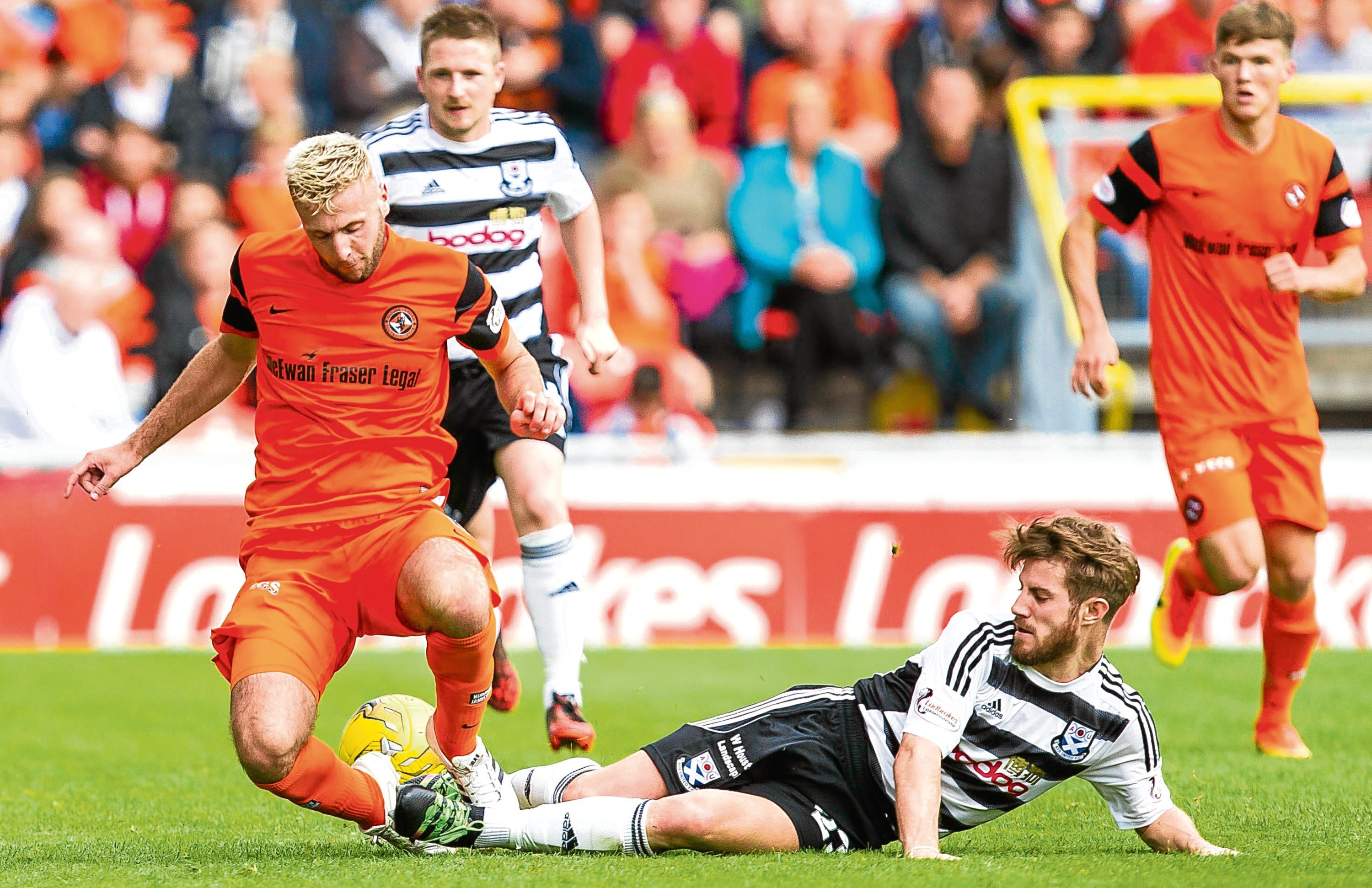 Lewis Toshney is tackled by Ayr United's Ross Docherty
