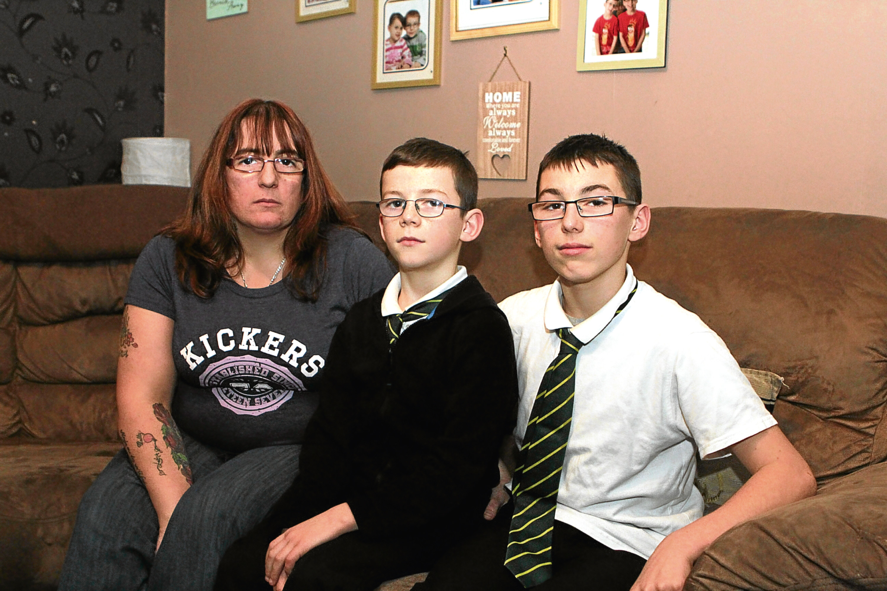 Kerry with sons Callan and Keiran. The pair were followed by a group of youths and Keiran was assaulted.