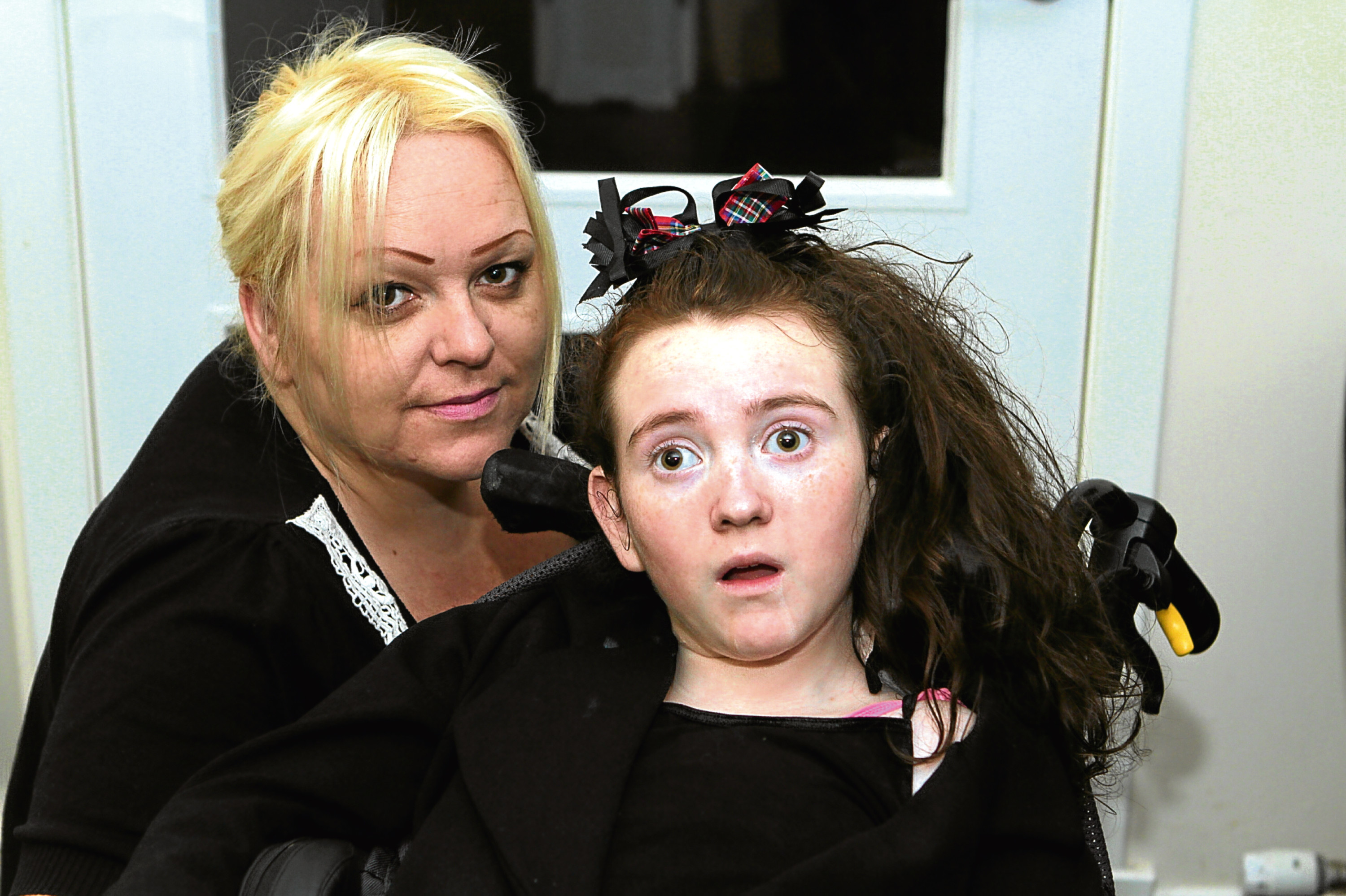 The teenager pictured at home with her mum, Michelle.