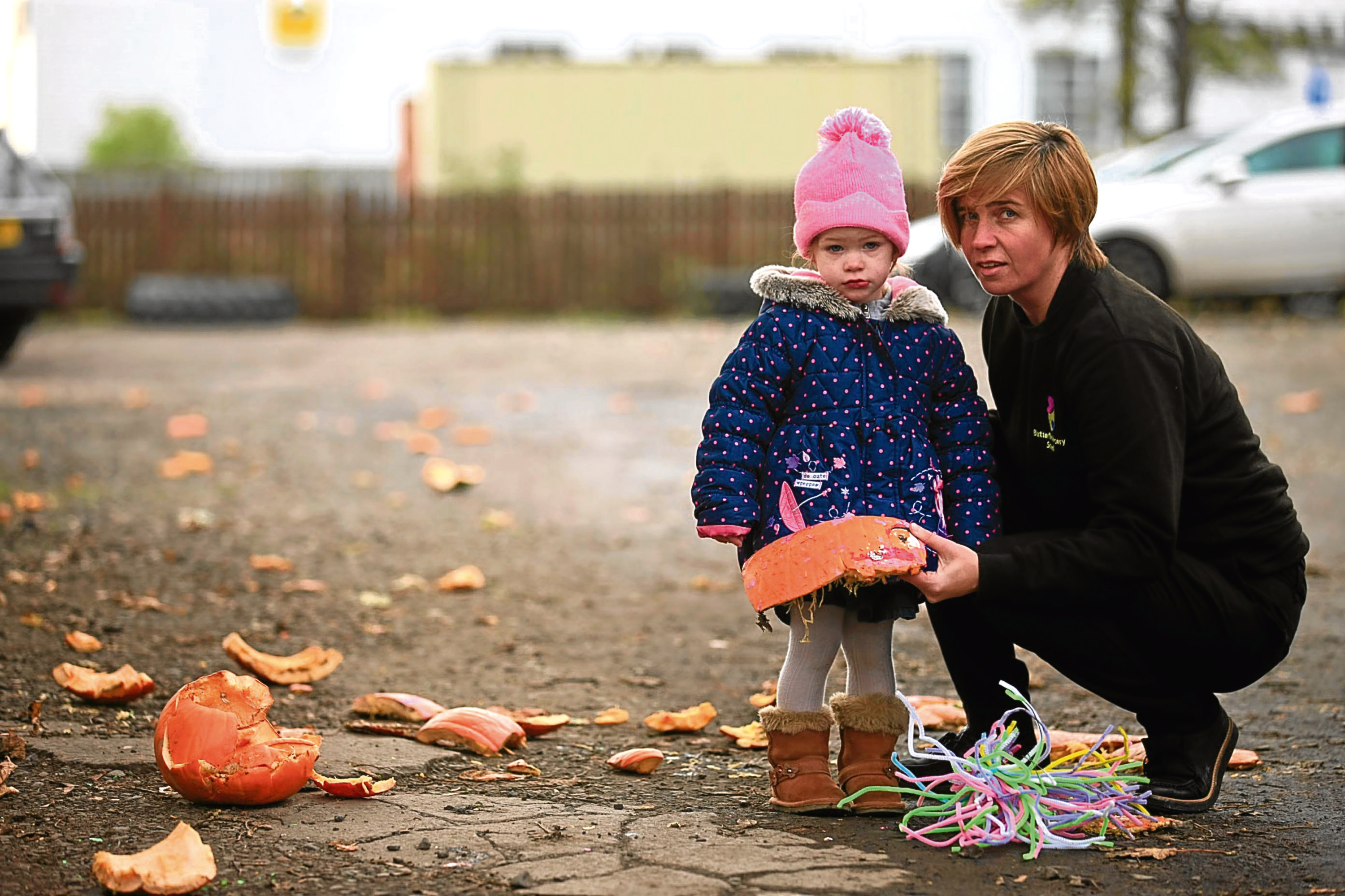 Two-year-old Teana McIntosh and Butterflies owner Teri Devine picking up the pieces at the nursery school.